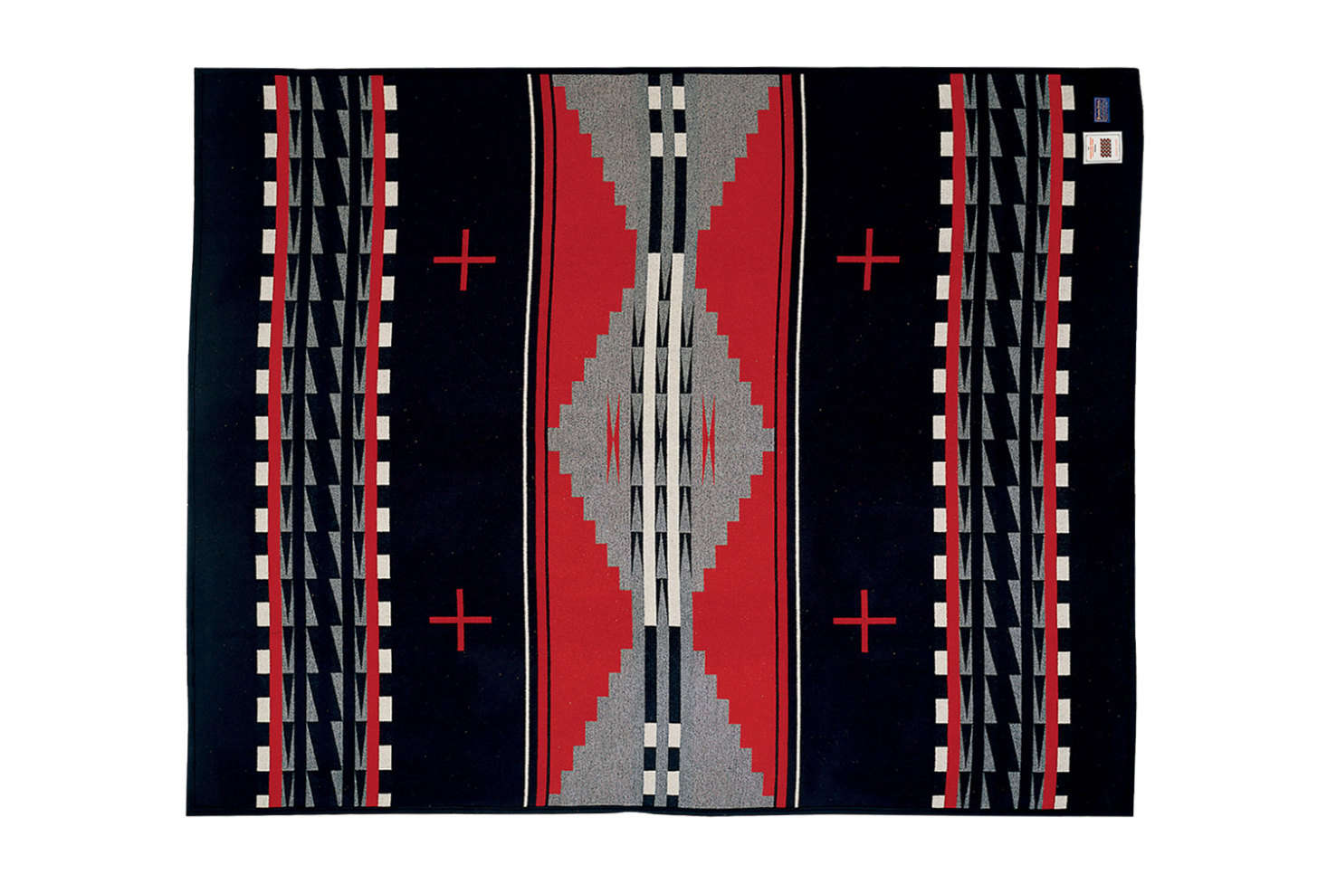 The Pendleton Earth Blanket in black multi is similar to the Pendleton blanket on the bed; $3 at Pendleton.