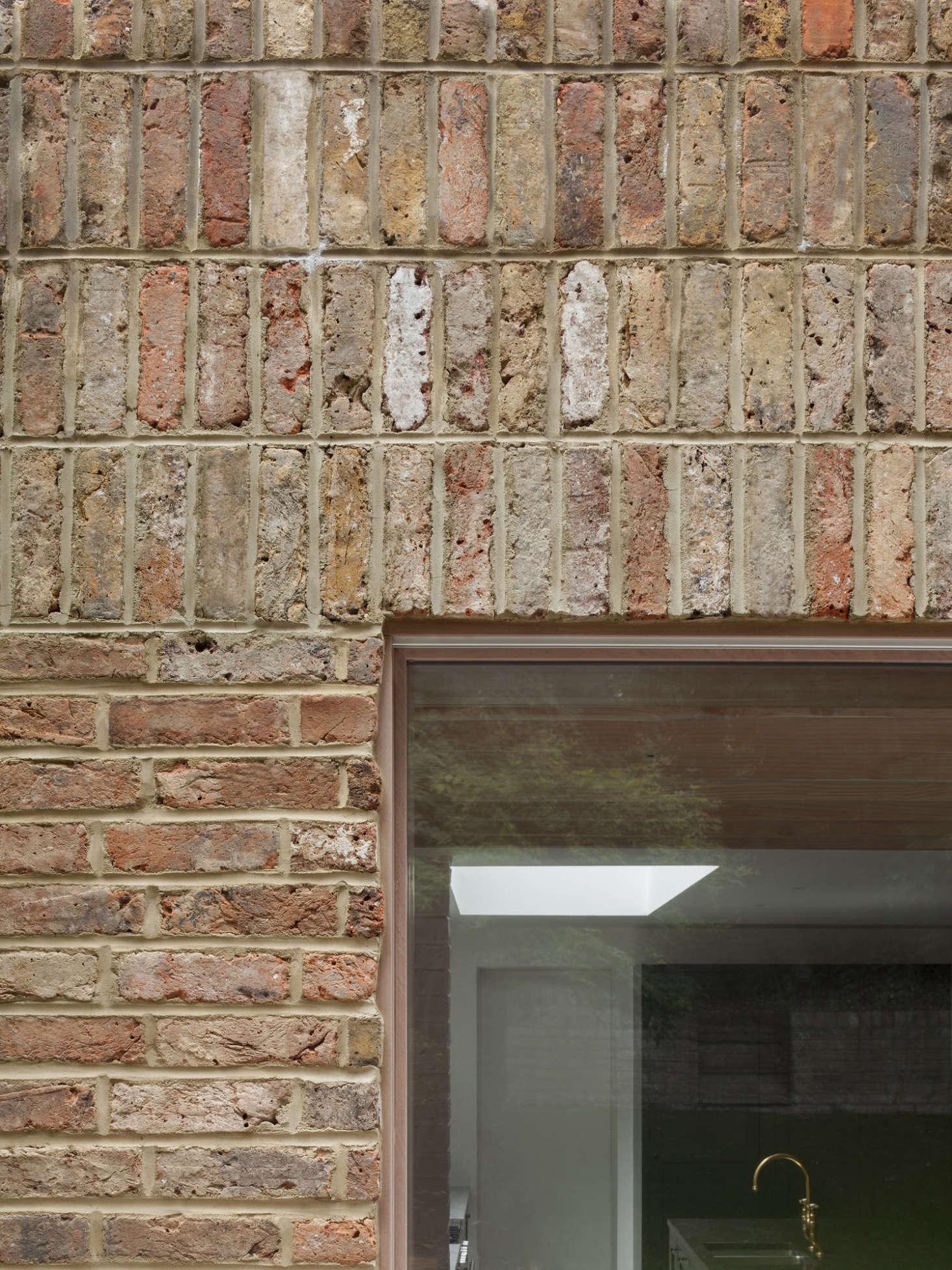 A look at where the sapele wood sliding door frame meets the brick façade.