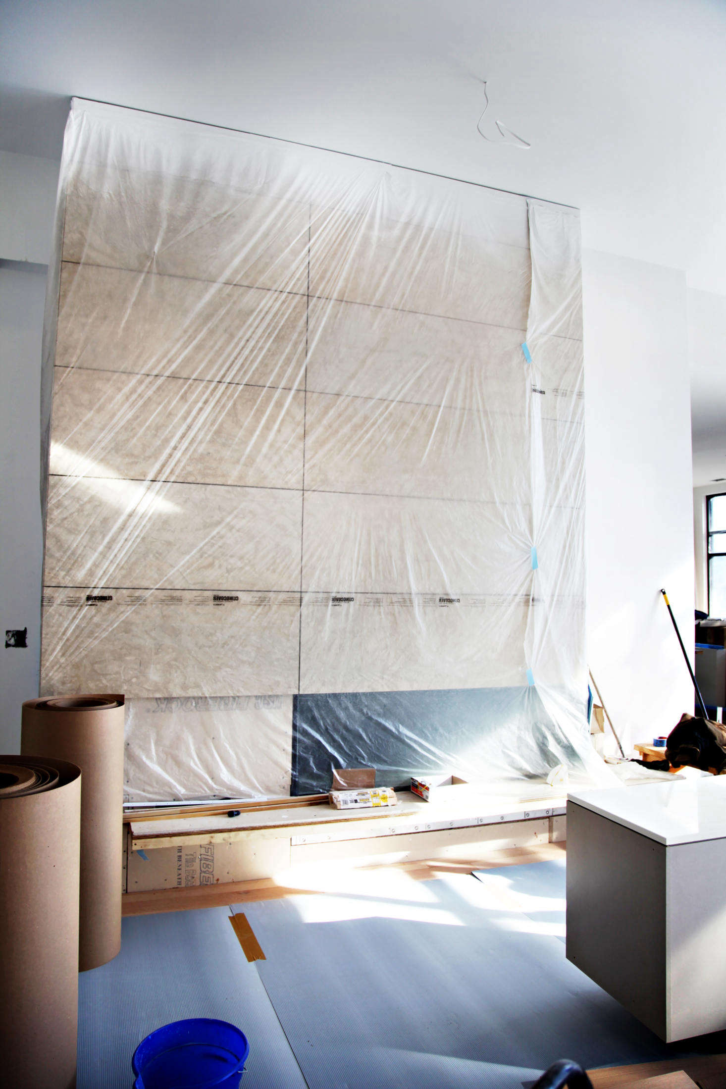 """For painting projects, Trimaco makes """"Cling Cover"""" plastic sheeting that self-adheres and clings to almost any surface. The film is treated with a formula that attracts paint overspray and can withstand multiple uses."""