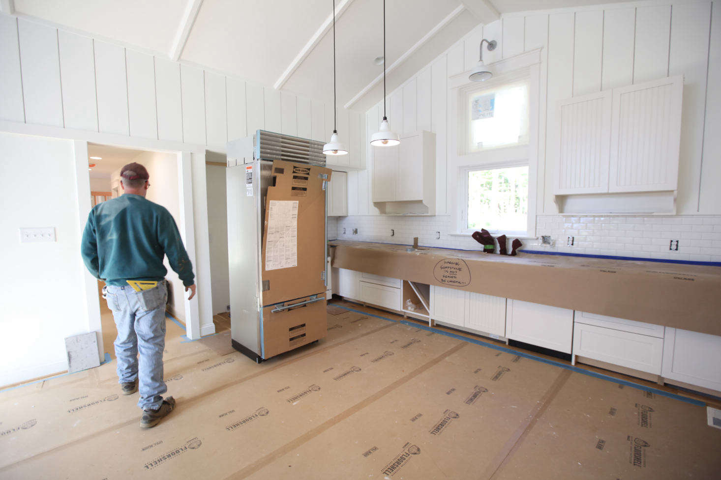 Appliance install in a kitchen with FloorShell protection on floors andX-Paper on the soapstone countertops. X-Paper is 1½ times thicker than standard contractor's paper.