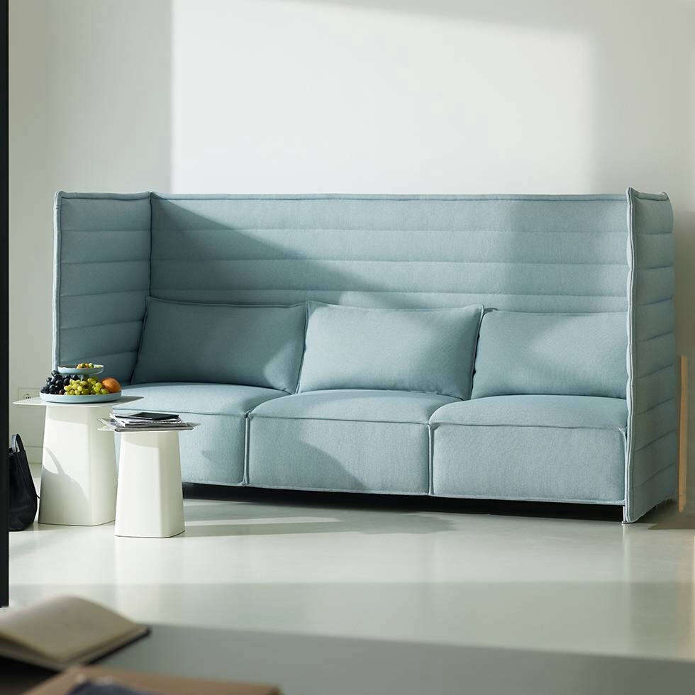"The Vitra Alcove Plume Three-Seater Sofa is a Ronan and Erwan Bouroullec creation with high, flexible sides and back panel and thick seat cushions that, according to Vitra, ""provide adequate support so that sitters do not sink in too deeply."" Made in Switzerland in a range of fabrics for $9,000 at YLiving."