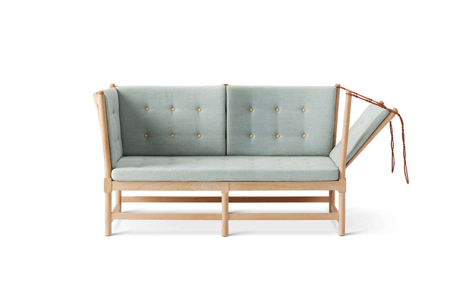 Børge Mogensen designed the Spoke Back Sofa in 1945 as an English daybed and French chaise combo, thanks to the hinged side. It's made from a solid oak frame and available in a range of upholstery options including leather, stripes, and woven plaid. Available in the US for $9,222 at Danish Design Store and in the UK for £7,621 at TwentyTwentyOne.