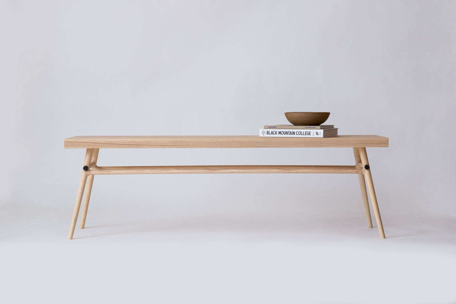 The Bough Bench can be customized to measure 60 inches to 72 inches and features minimalist blackened steel hardware on the cross beams. The hardworking bench can also be used as a coffee table; $1,800.