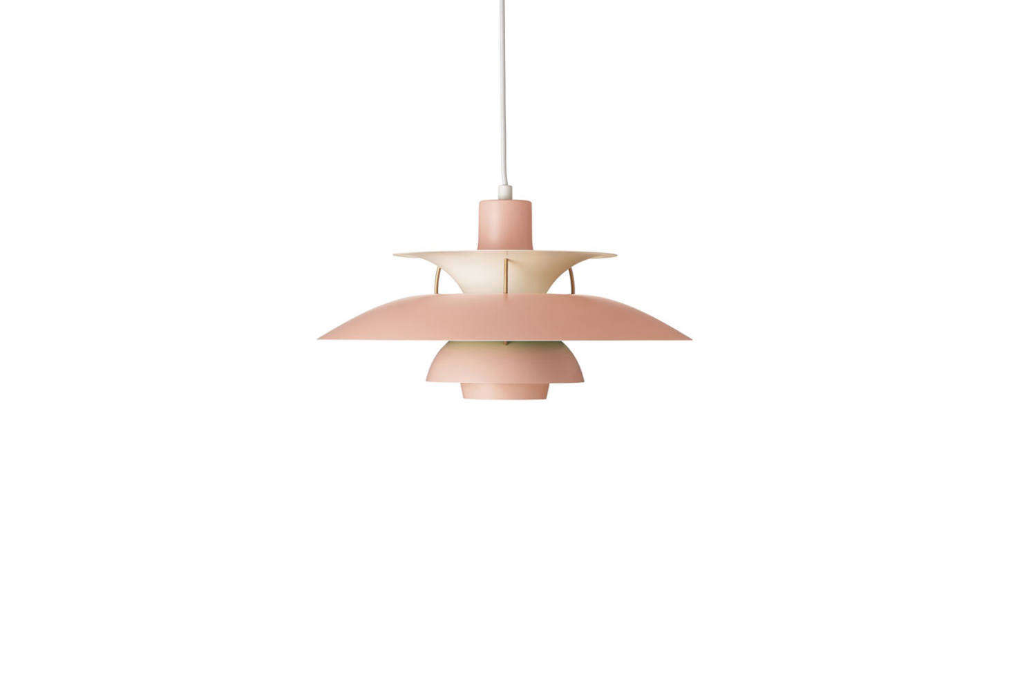 Hanging over the dining table are two Louis Poulsen Ph5 Pendant Lights in pink; $996 each at Design Within Reach.