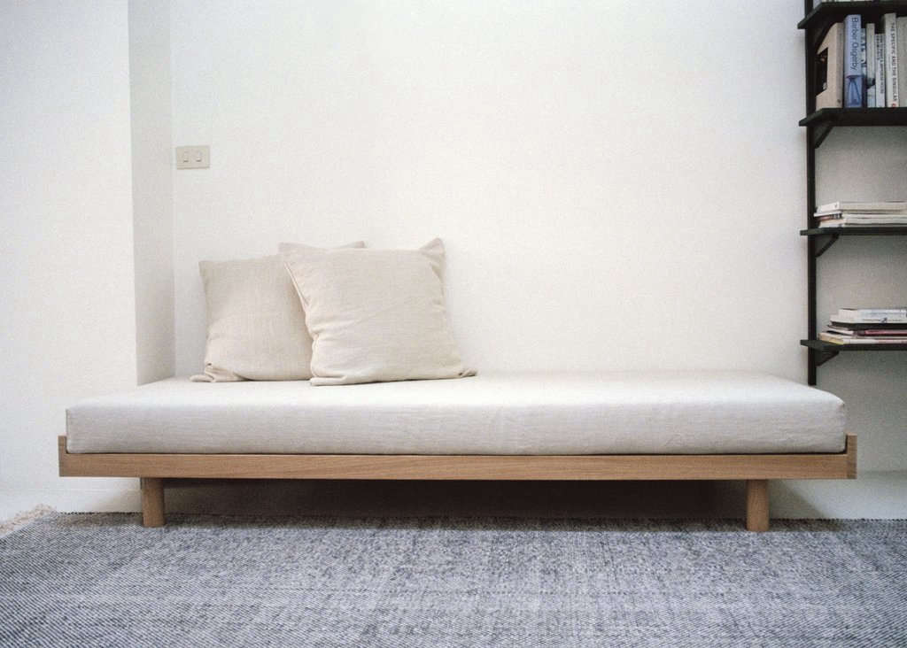 The solid oak Daybed with mattress and down cushions is €src=