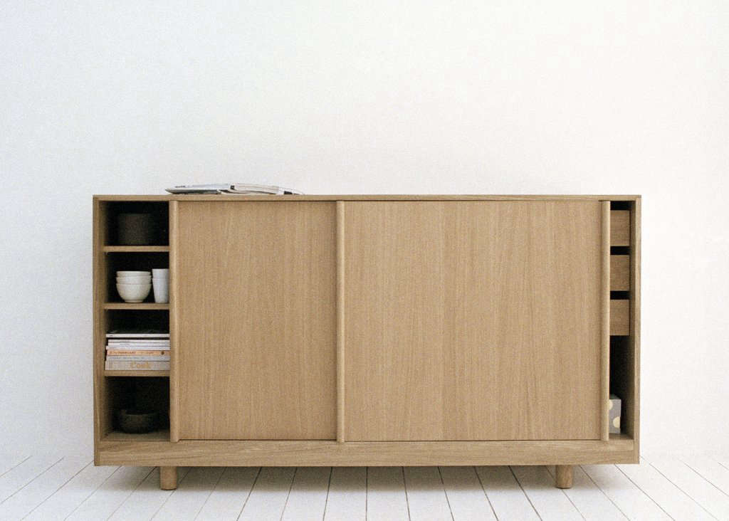 The oak Sideboard with Sliding Doors is €