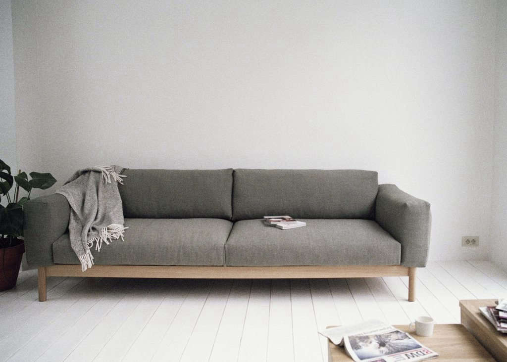 The Three-Seater Sofa has a solid oak base and down/feather-wrapped polyurethane foam cushions; €3,900.
