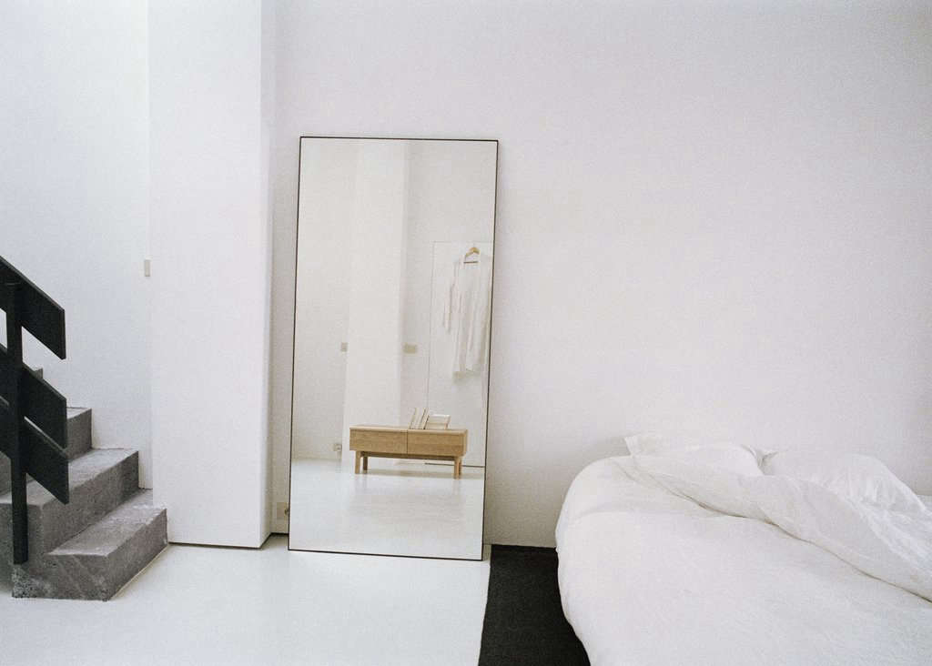 The Steel Frame Mirror has a dark green lacquered steel frame; the small size is €660 and the large size is €690.