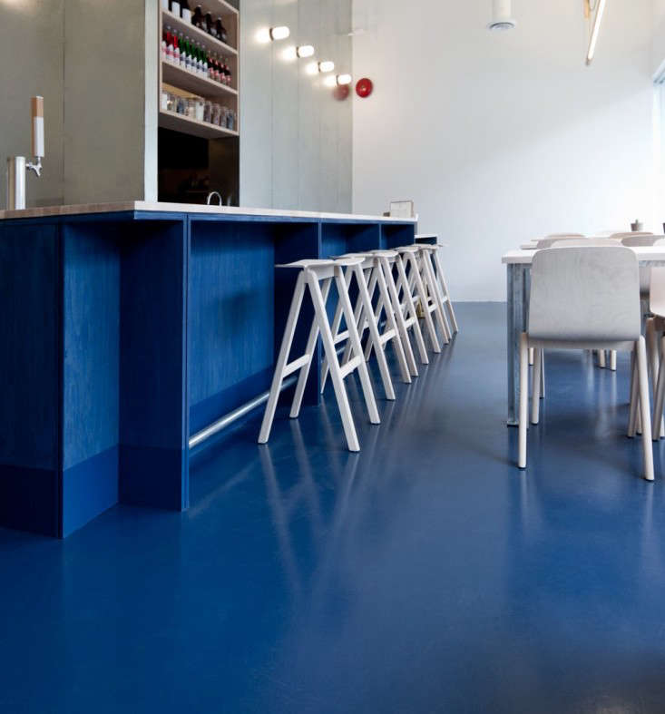Marine blue floors at Kin Kao Thai Kitchen in Toronto, designed by Scott & Scott Architects.