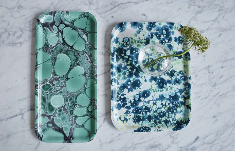 At left, the birch veneer Deep Jade Cocktail Tray is 9. KR (approximately $ USD). At right, the birch veneer Aqua Breakfast Tray is also 9. KR.