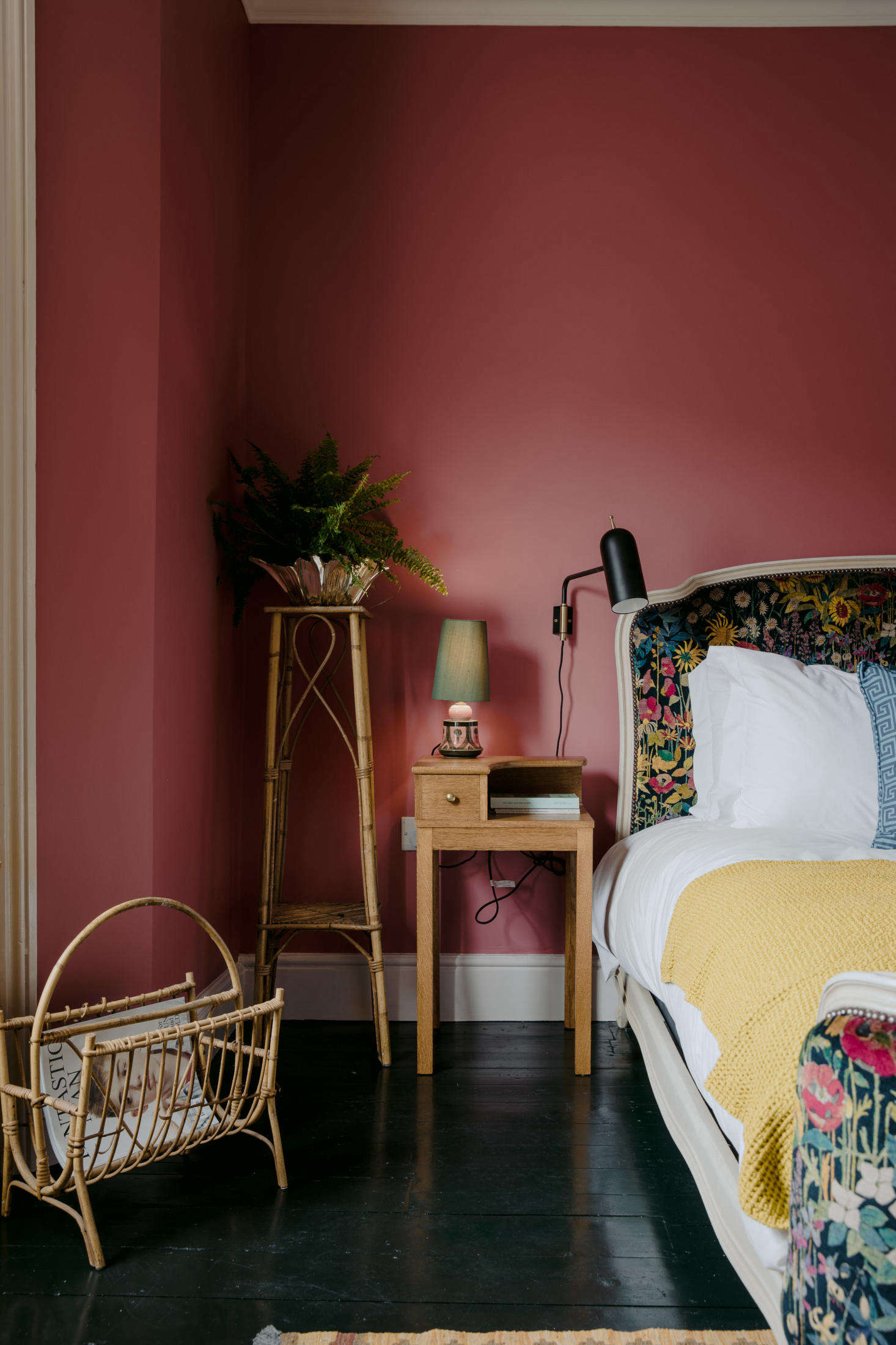 "At this inventively colorful English inn, walls painted a deep Rhubarb by Paint & Paper Library pairs with black floors and velvet fabric in a floral pattern by Liberty London. ""I really pushed for this color,"" the stylist told us. ""Everyone was against it, but I got quite obsessed.&#8"