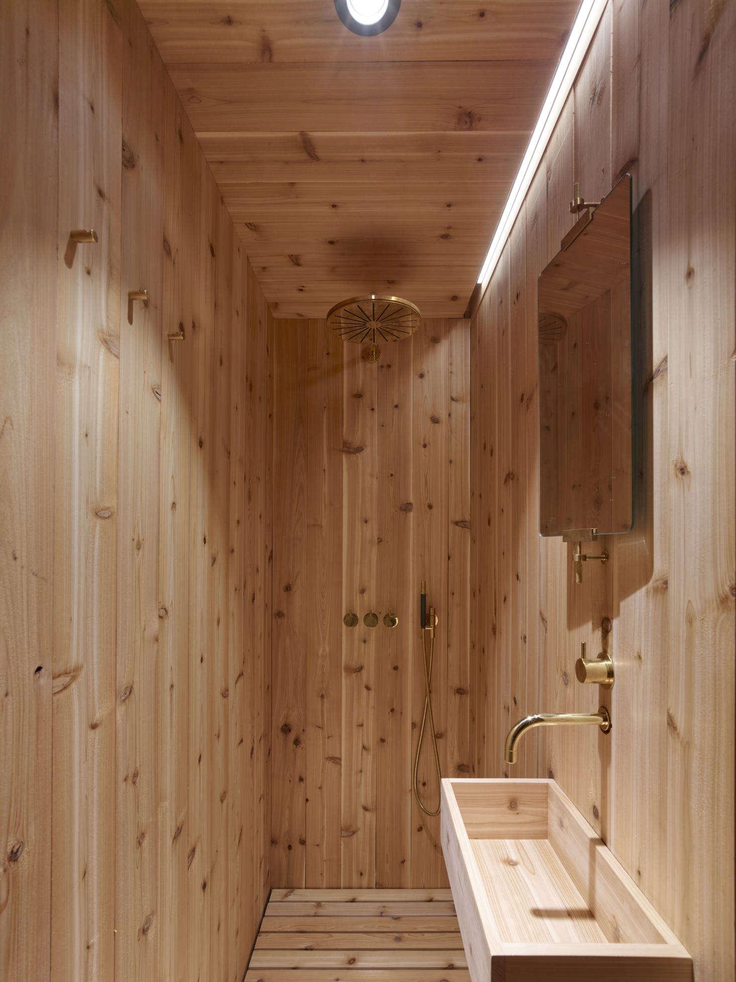 The bathroom is all cedar, down to the trough sink.