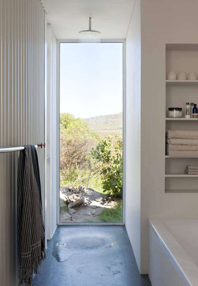 The shower in the bathhouse is partially outdoors (through the doorway to the left) with a Grohe Rainshower Cosmopolitan