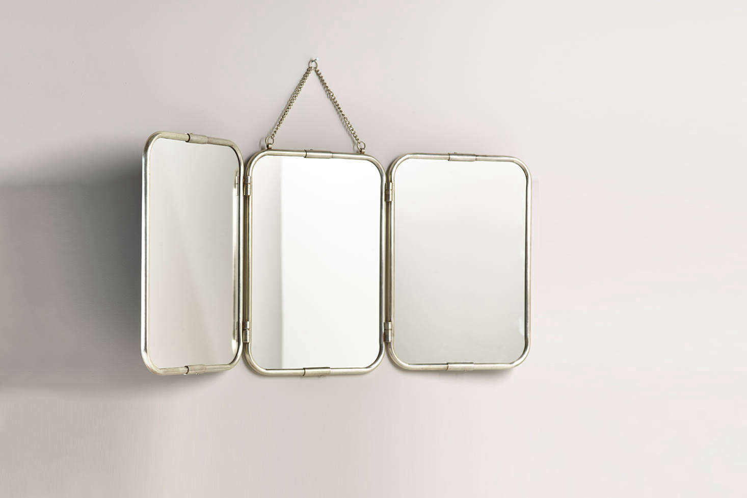 The Large French Triple Mirror is an oversize version of the small vintage mirror seen on the bedside table here. This one is £5 at Cox & Cox. For more mirrors on chains, see our post on The Organized Home  Easy Pieces: Square and Rectangular Shaped Hanging Mirrors.