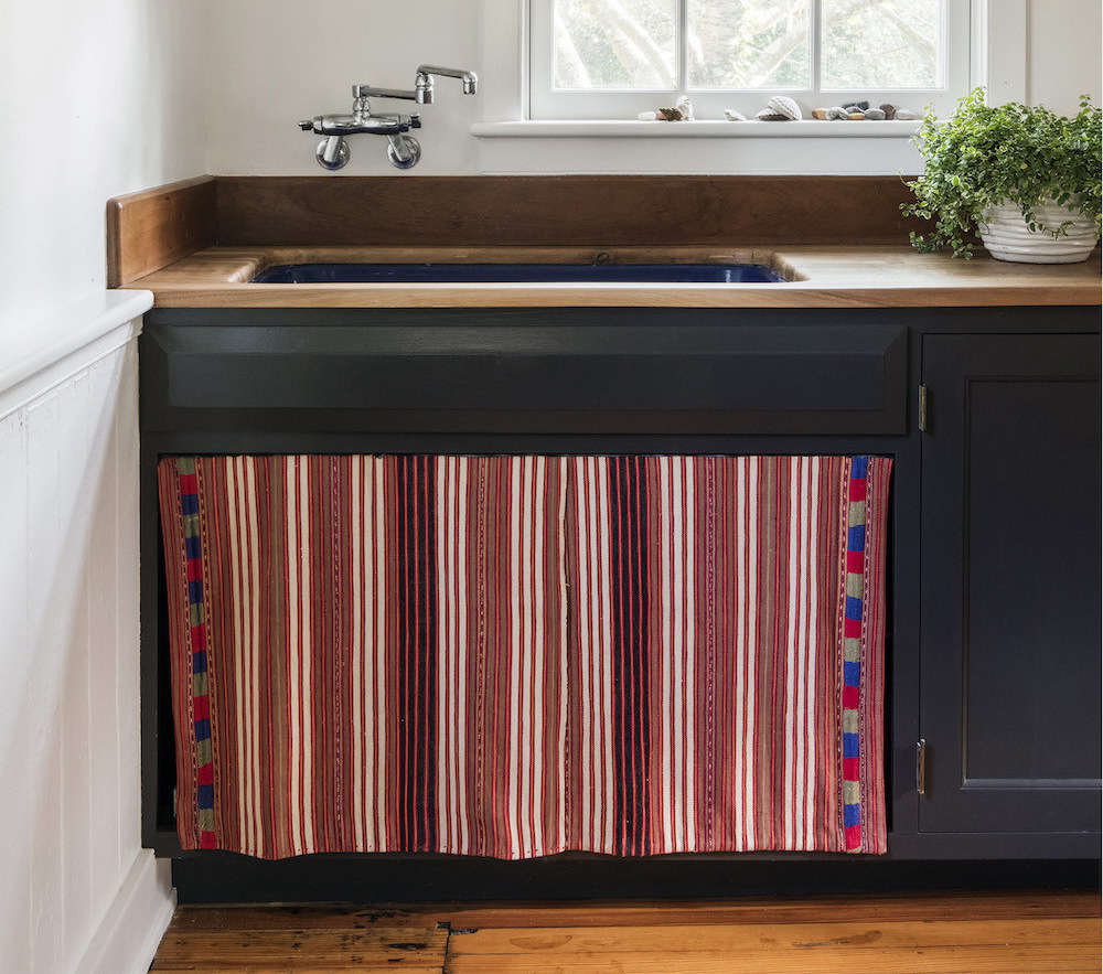 In her Bellport, NY, summer house, architectElizabeth Roberts had a sink skirt sewn froma vintage Guatemalan textile in lieu of cabinet doors (see Elizabeth Roberts at Home: The Architect's Own Beach House). For more ideas, go toNew Old Trend: 10 Fresh Examples of Sink Skirts and Cabinet Curtains on The Organized Home.