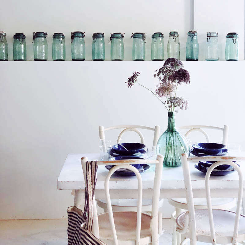 A row of green glass canning jars.