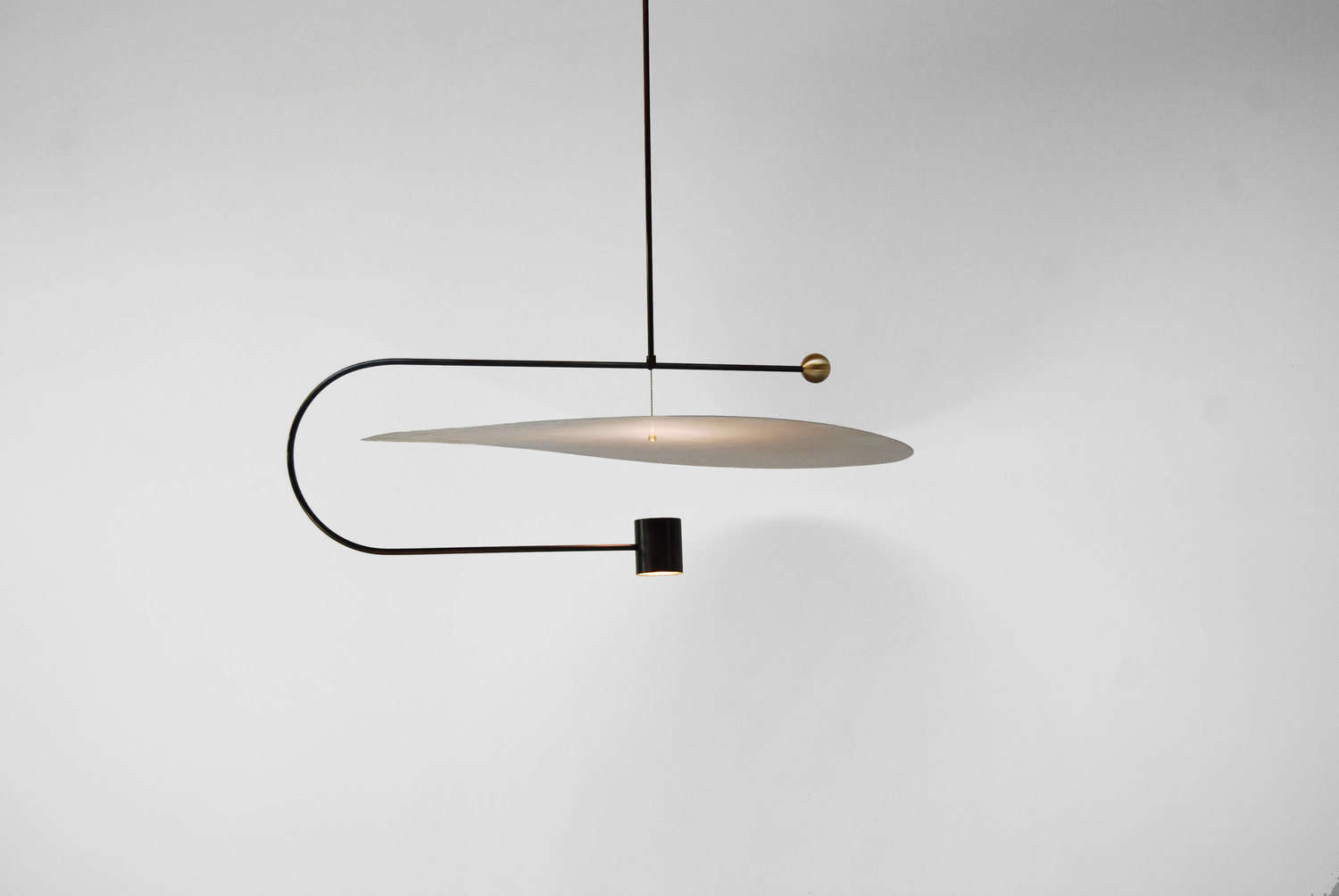 Babies arent the only ones mesmerized by mobiles of late weve been admiring sculptural pendant lights that take inspiration from calder and in many cases