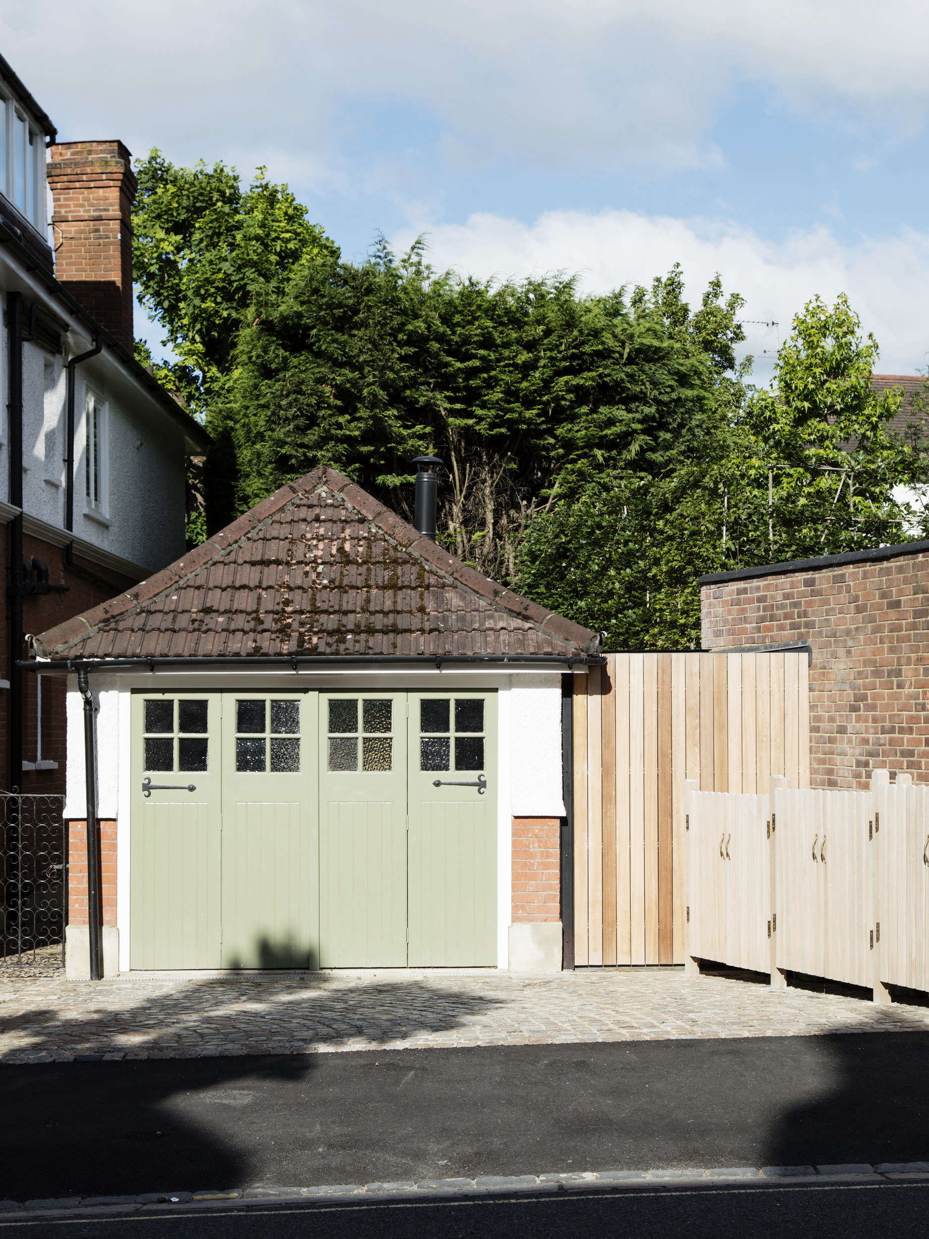 A Garage Converted into a Compact Guest Cottage, Courtesy of