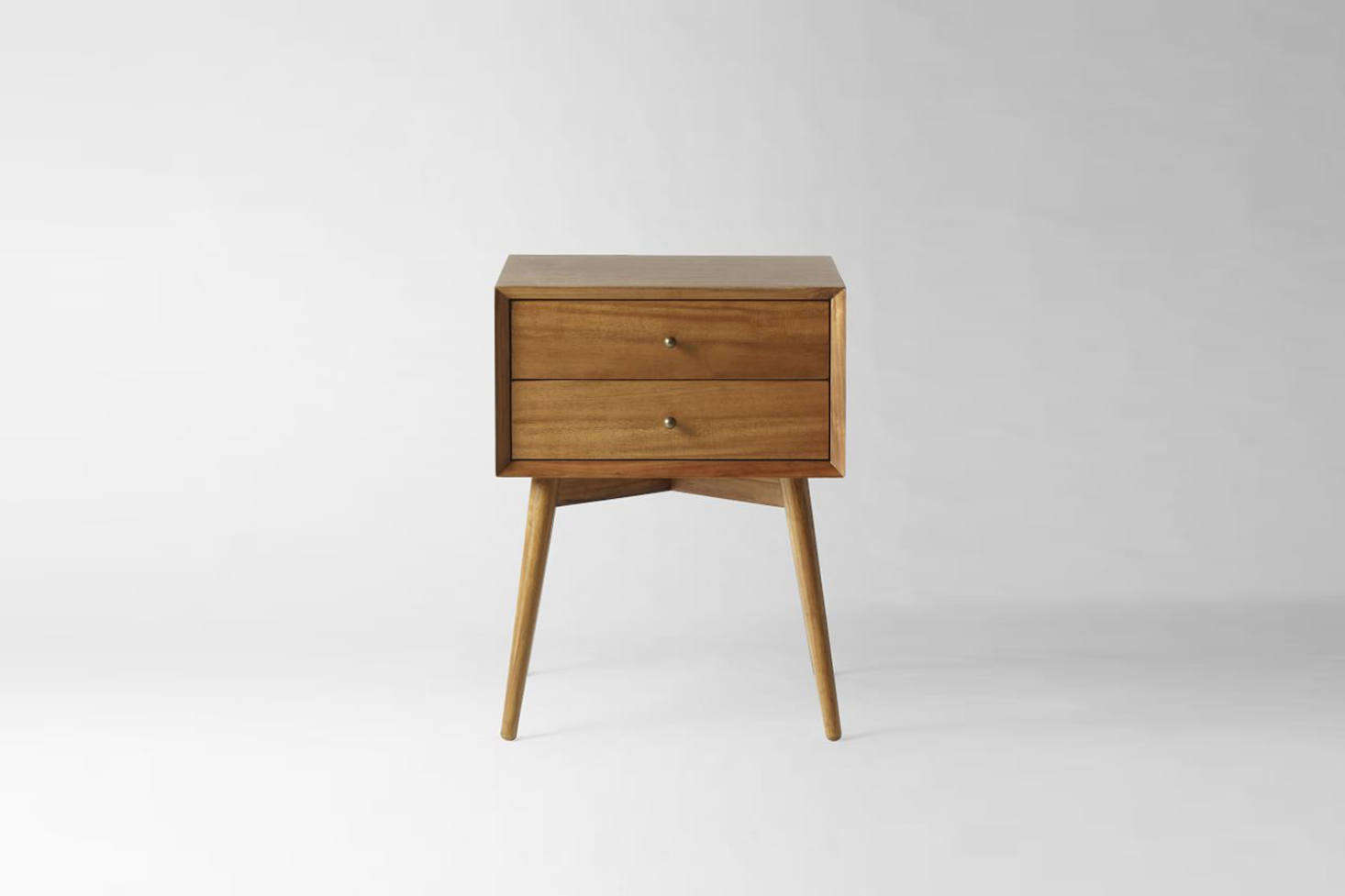 A similar Mid-Century Nightstand in an acorn-colored finish is $9 at West Elm.
