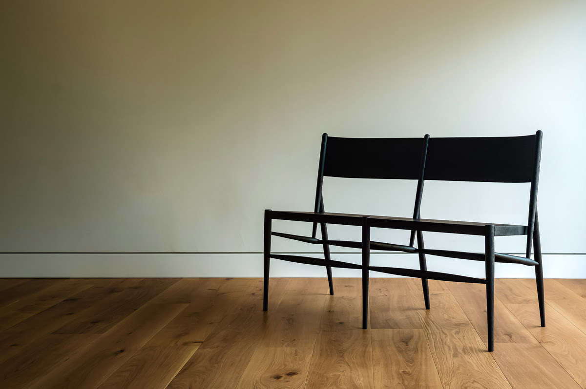The &Bespoke Bure Settle is available in solid oak with an oiled or ebonized finish; £1,245. For more see our post A New Furniture Collection from &Bespoke in Hampshire, England.