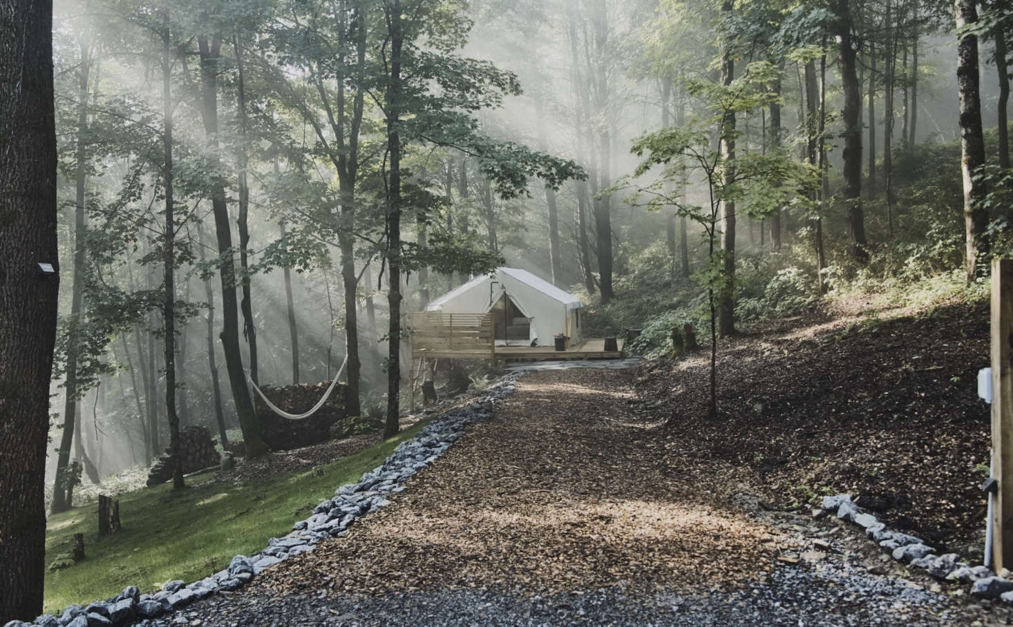 There are nine tent sites, each with its own hammock and wall of firewood. Solar-powered lights illuminate the paths at night. Photograph by Nick Bean.