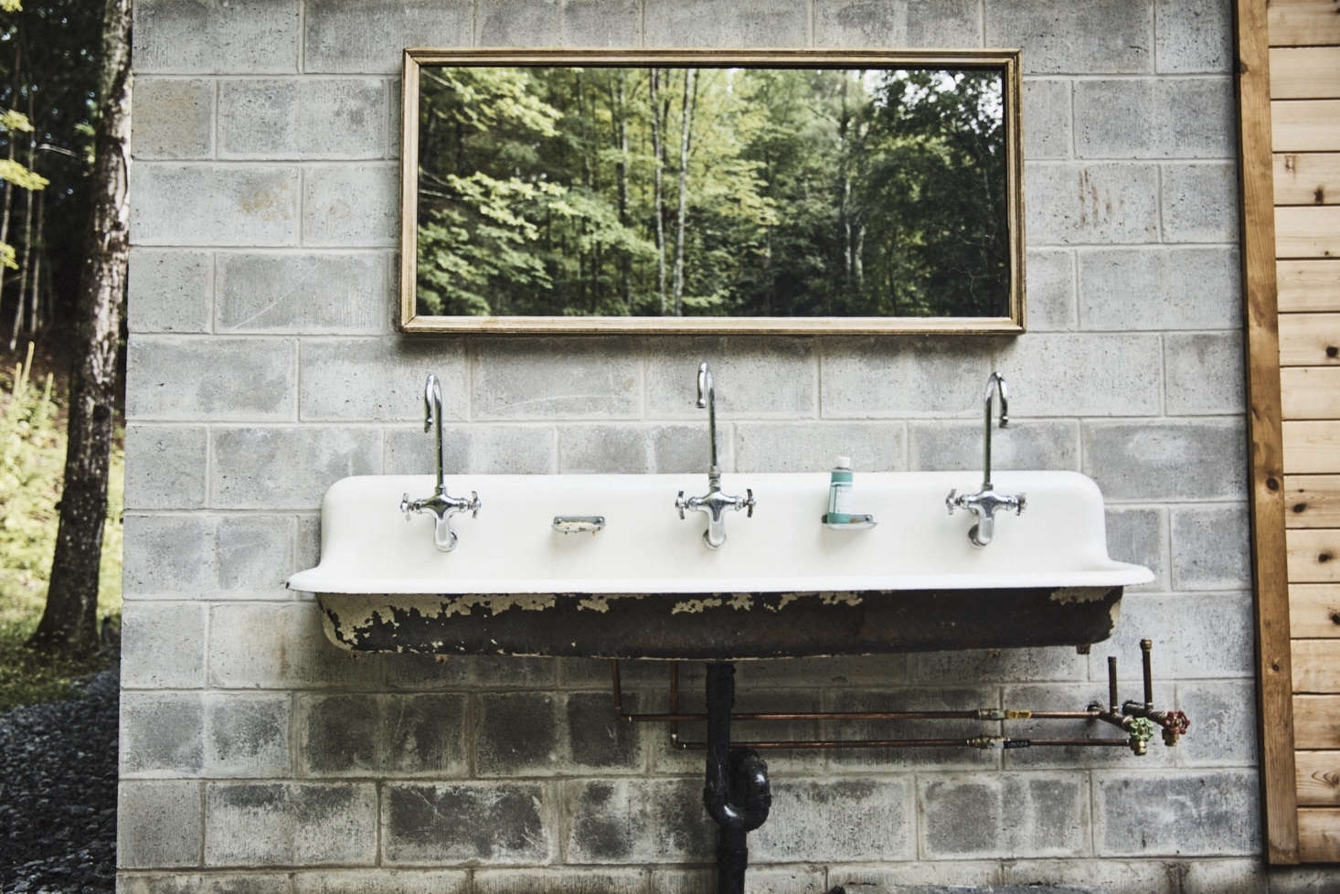 Another Aesthetic Movement touch: A vintage communal sink outside The Mess and a mirror positioned to capture the landscape.