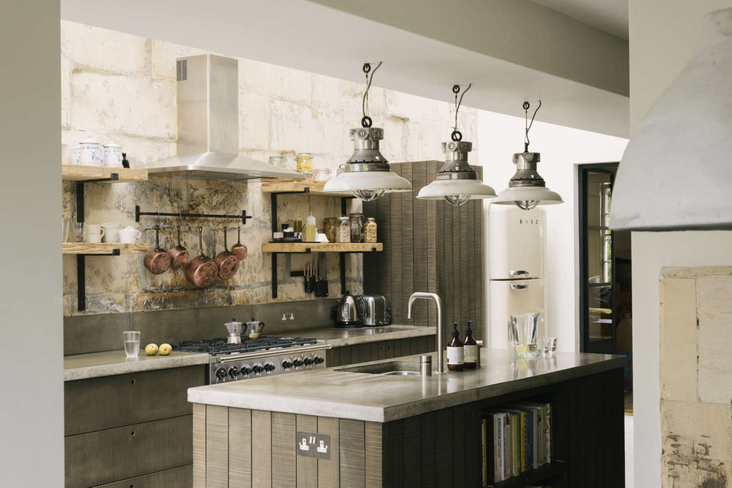 The trio of lights over the island are Vintage Appleton American Warship Enamel Pendants from Bath lighting dealer Felix. For similar rescued designs, see Reborn in the USA: Soviet Industrial Lighting from Fixt Electric.