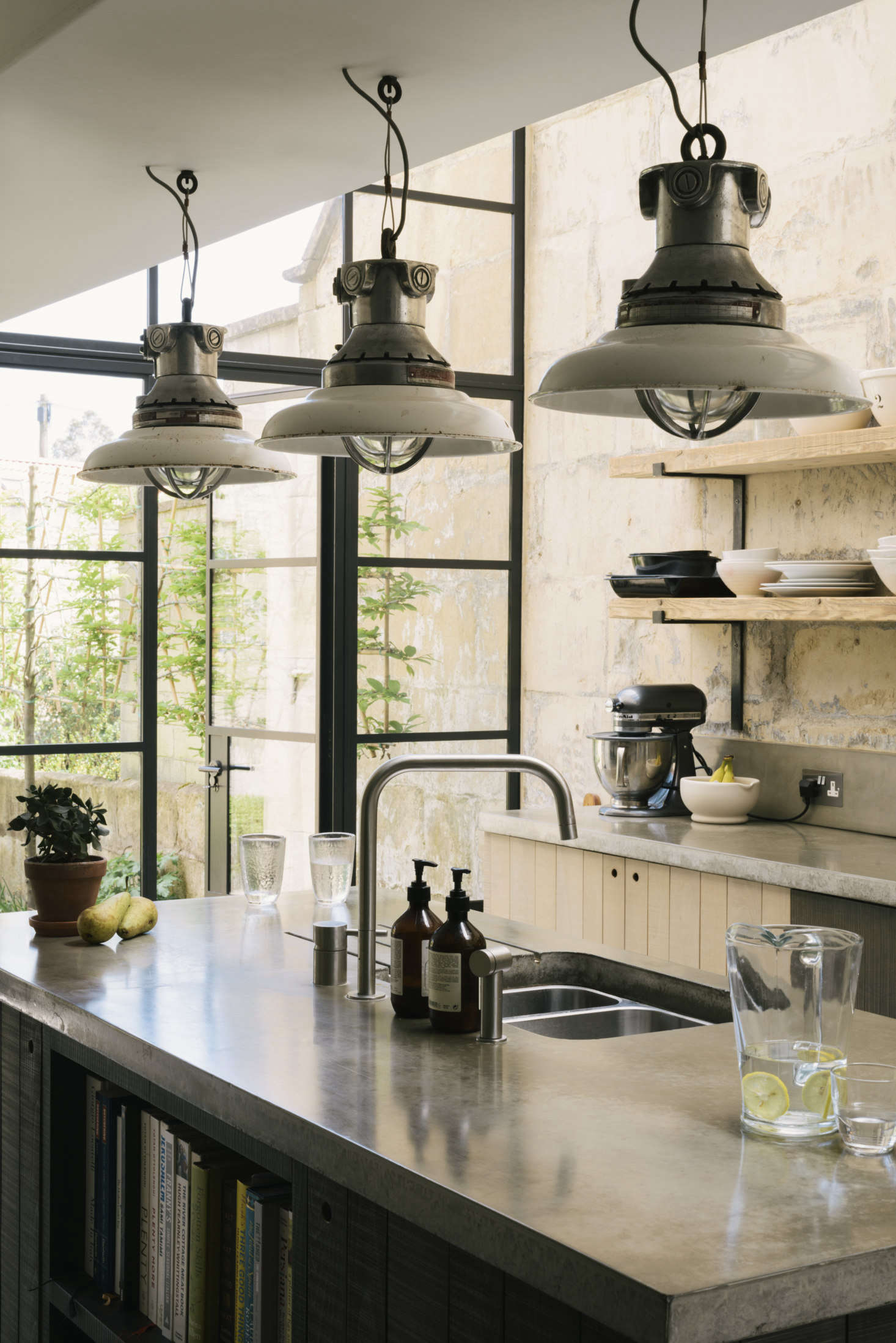 The brushed-stainless-steel undermountdouble-bowl sink and theF