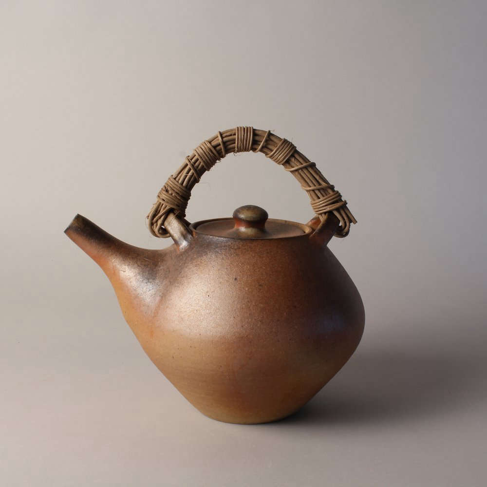 Lincolnville, Maine, native Meghan Flynn cites her daily life and the flora and fauna of her coastal home as inspiration for her crafts. The Wood-Fired Teapot shown above is part of a set of 100 pieces she fires in a wood-fired anagama kiln in Swanville, Maine, once a year. The wood-fired kiln, she says, takes four days to load and is stoked round-the-clock for eight days to create a set of one-of-a-kind pieces.