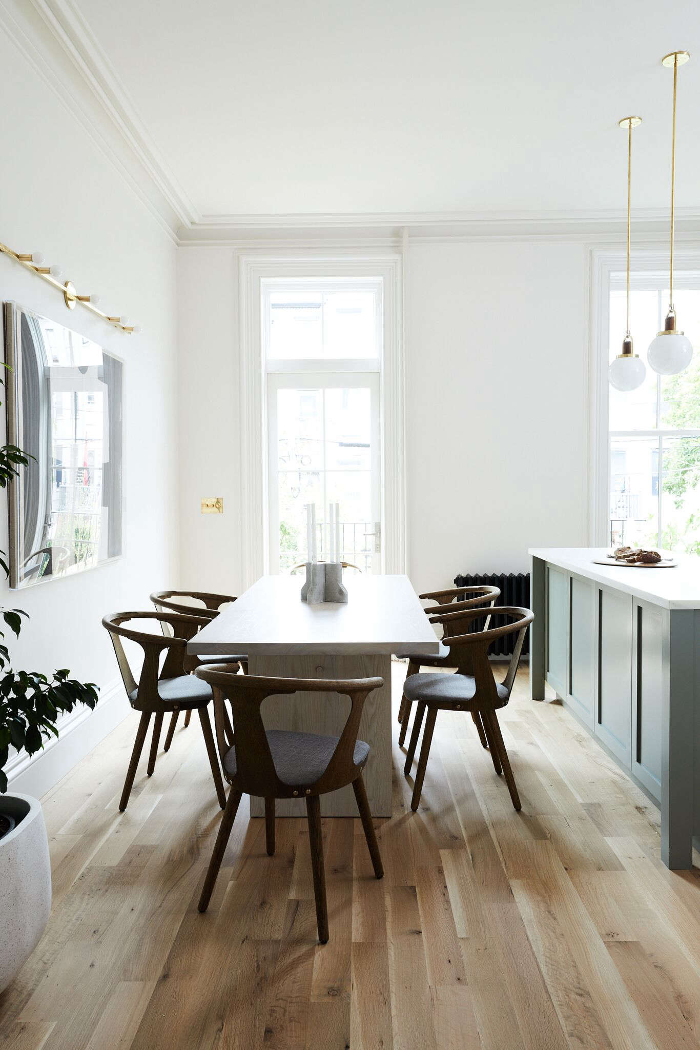 The dining room adjacent to the kitchen island. Photograph by Nicole Franzen from Rehab Diary: Monochromatic Luxe in Park Slope.