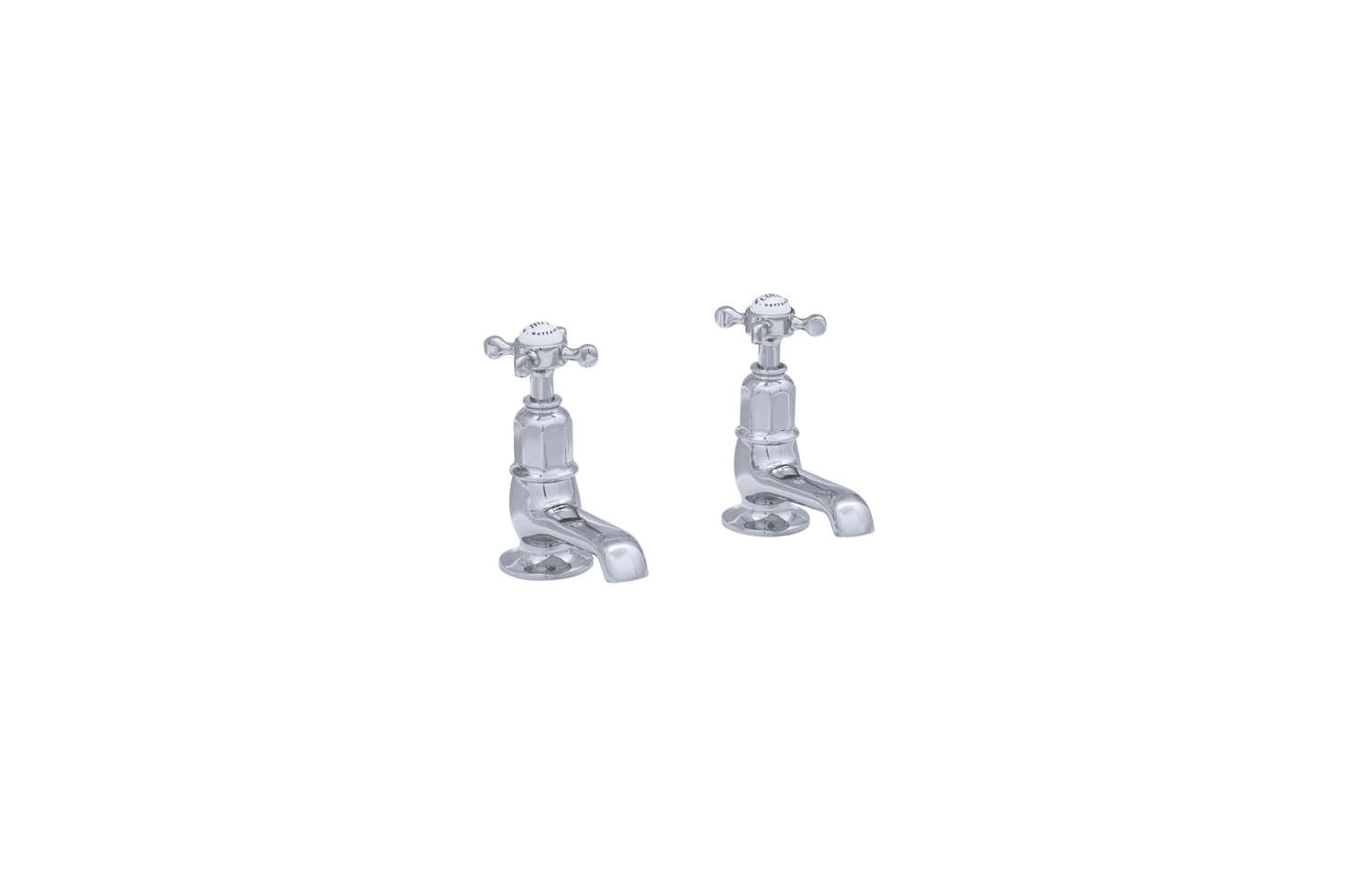 If you have access to a good salvage yard or supplier, pair taps like the Perrin & Rowe Pair of Basin Pillar Taps with Crossheads with a vintage mint green pedestal sink. The taps are available from the English Tapware Co.; contact them for pricing and ordering information.