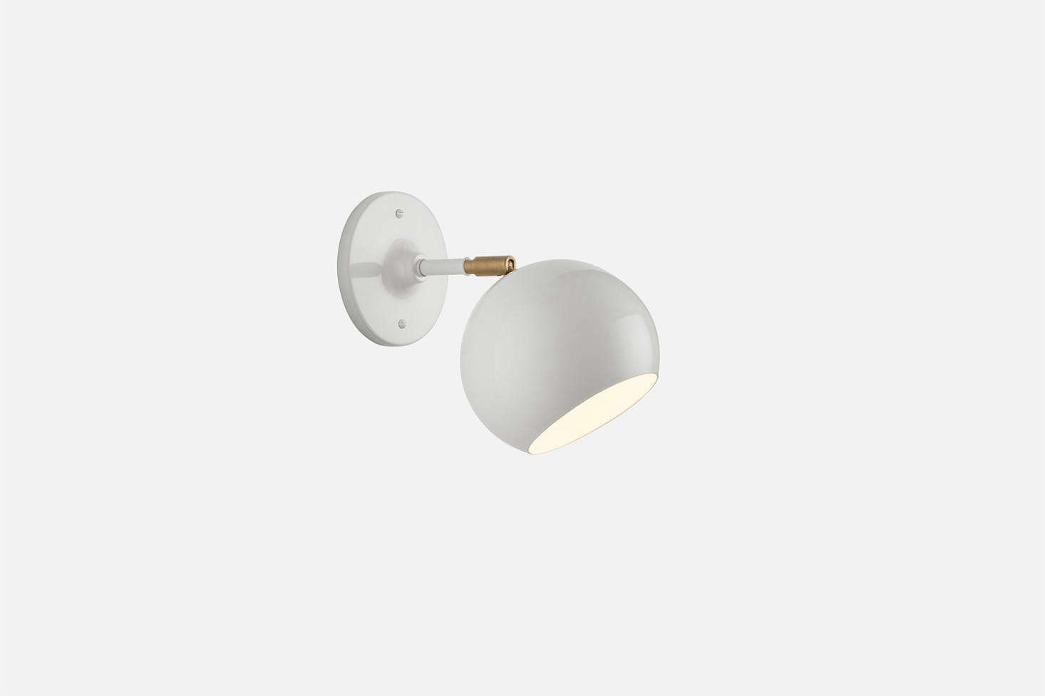 TheIsaac Sconce with a short arm is inspired by midcentury Scandinavian lighting and available in black, white, and Persimmon; $139 at Schoolhouse. It's also available as aPlug-In Sconce; $189.