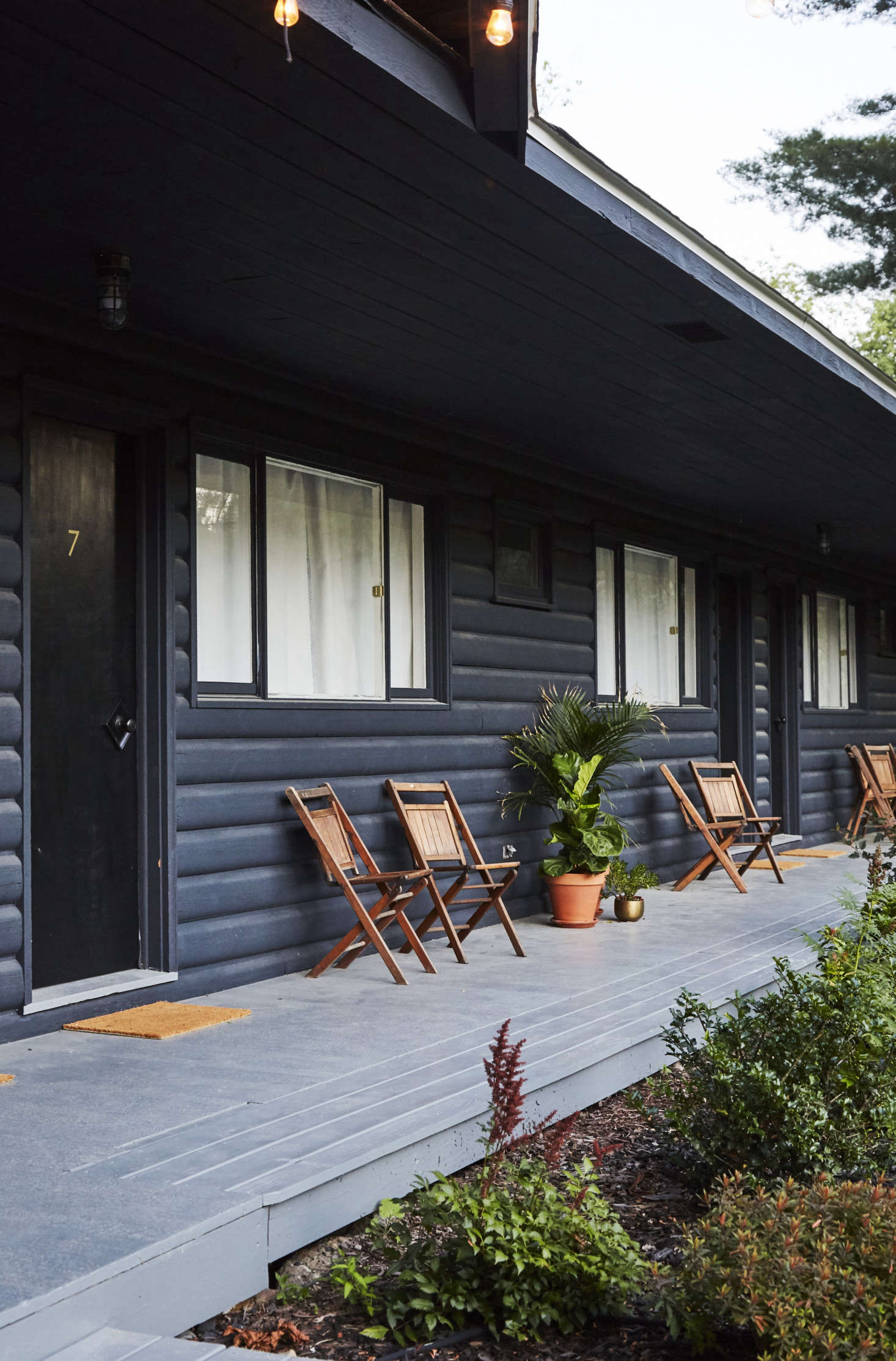 The wooden folding chairs on the porch are original to the lodge.