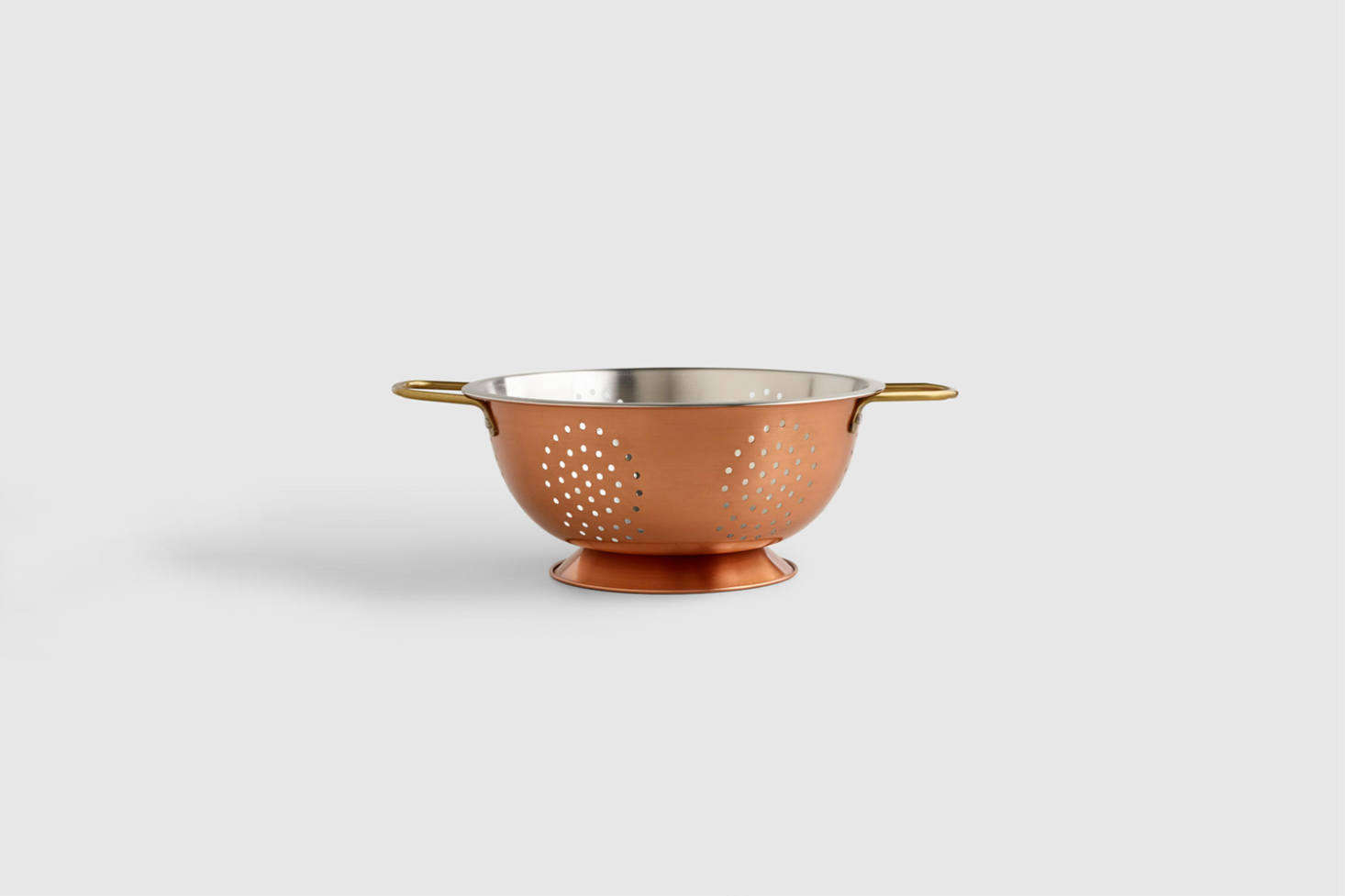 TheCopper Colander with a stainless steel interior is $src=