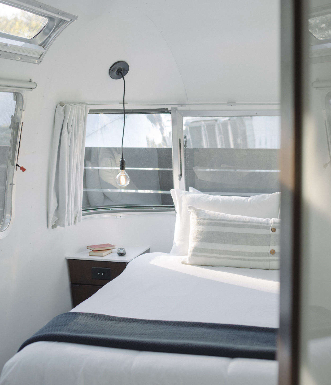 Each Airstream has a queen bed with a Casper mattress dressed in Coyuchi linens.