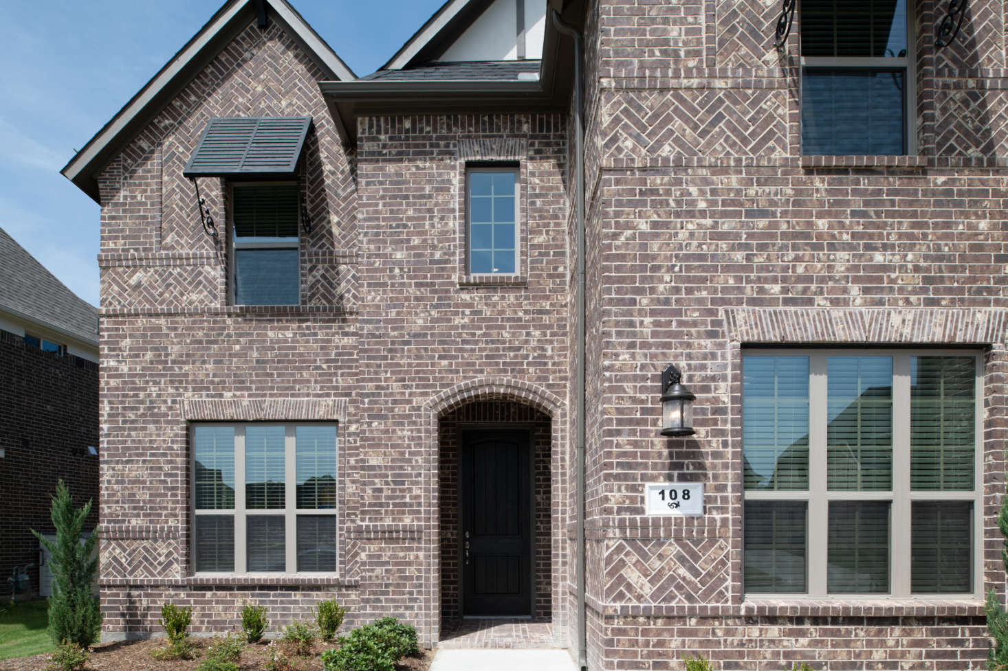 A Texas home sports dark brick in several bond patterns. Photograph courtesy of the Brick Industry Association.