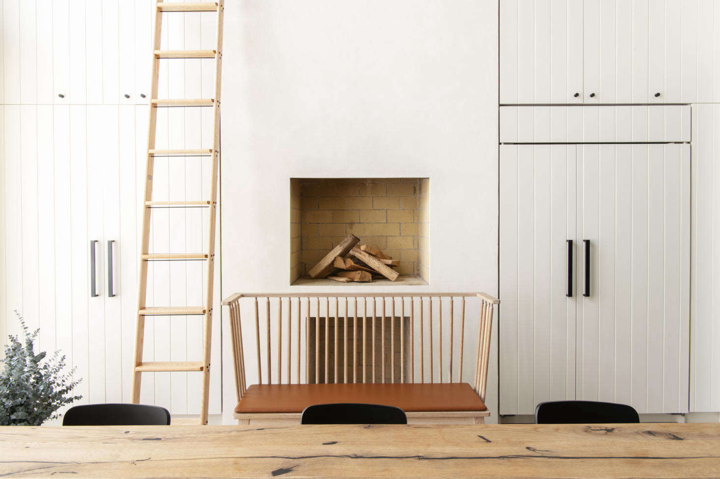 Above: The wood-burning fireplace, a regular fixture in Roberts' kitchen designs, is made to be fitted with a pizza oven, Korean-style barbecue, and other inserts. Photography by Dustin Askland, courtesy of Elizabeth Roberts from Serial Remodelers Settle Down: A Brooklyn Townhouse Reinvention from Elizabeth Roberts.