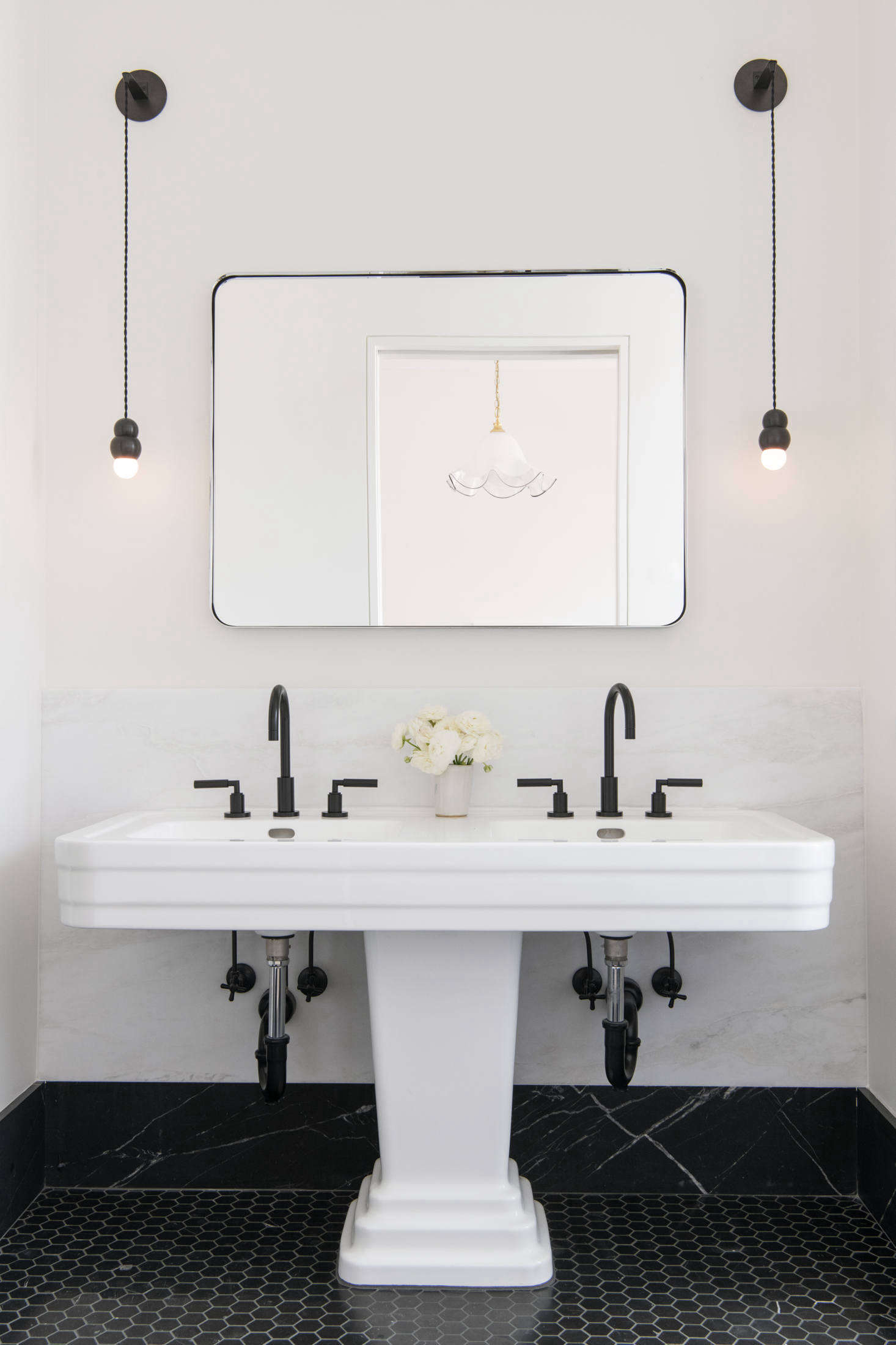 A vintage Art Deco double sink, upgraded with modern fixtures, is the pièce de résistance in the room.