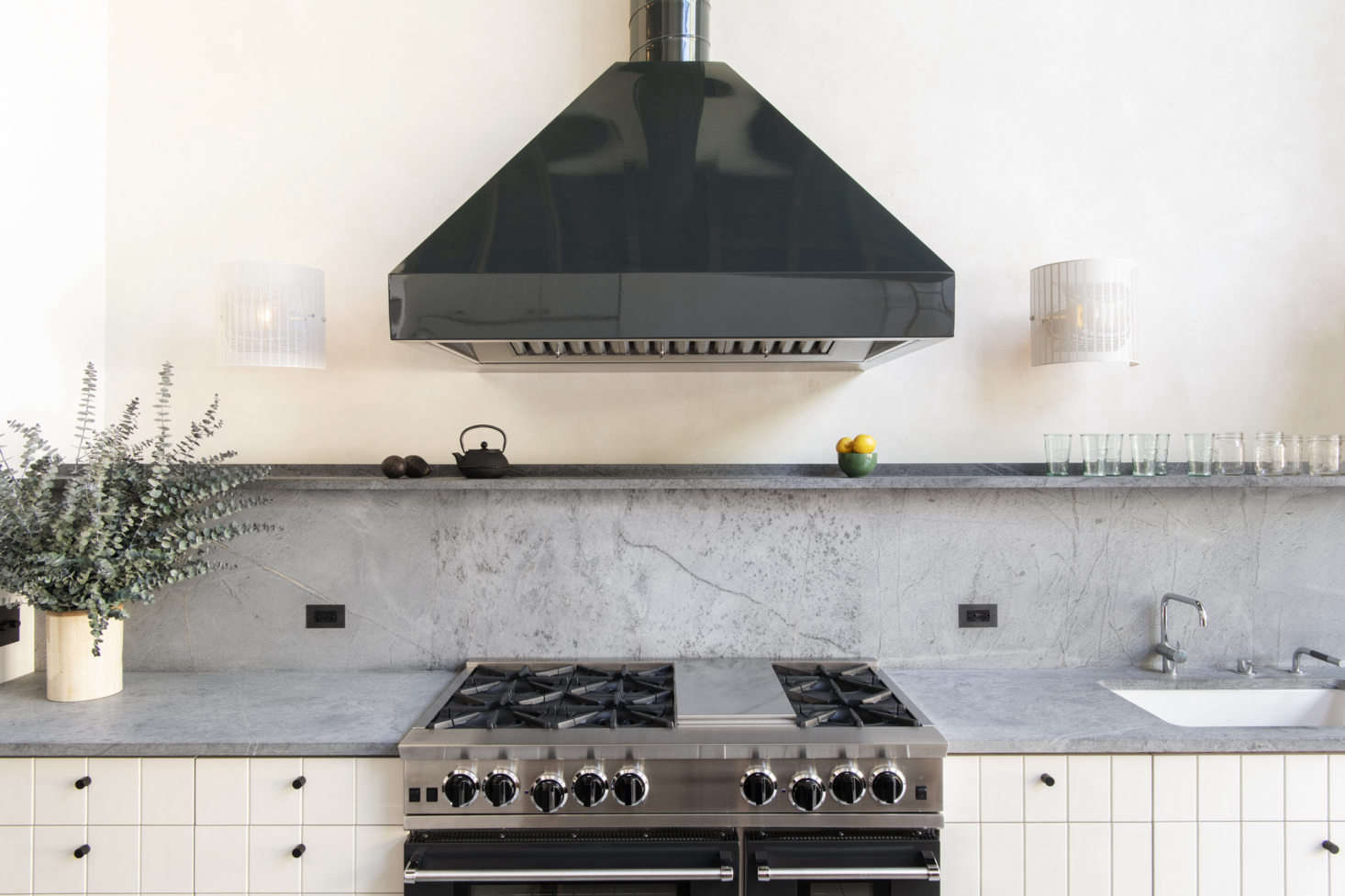 A straight-on view of the custom colored range from Blue Star, a company that offers a wide range of powder coated colors. Countertop and backsplash are Vermont soapstone. Photography by Dustin Askland, courtesy of Elizabeth Roberts from Serial Remodelers Settle Down: A Brooklyn Townhouse Reinvention from Elizabeth Roberts.