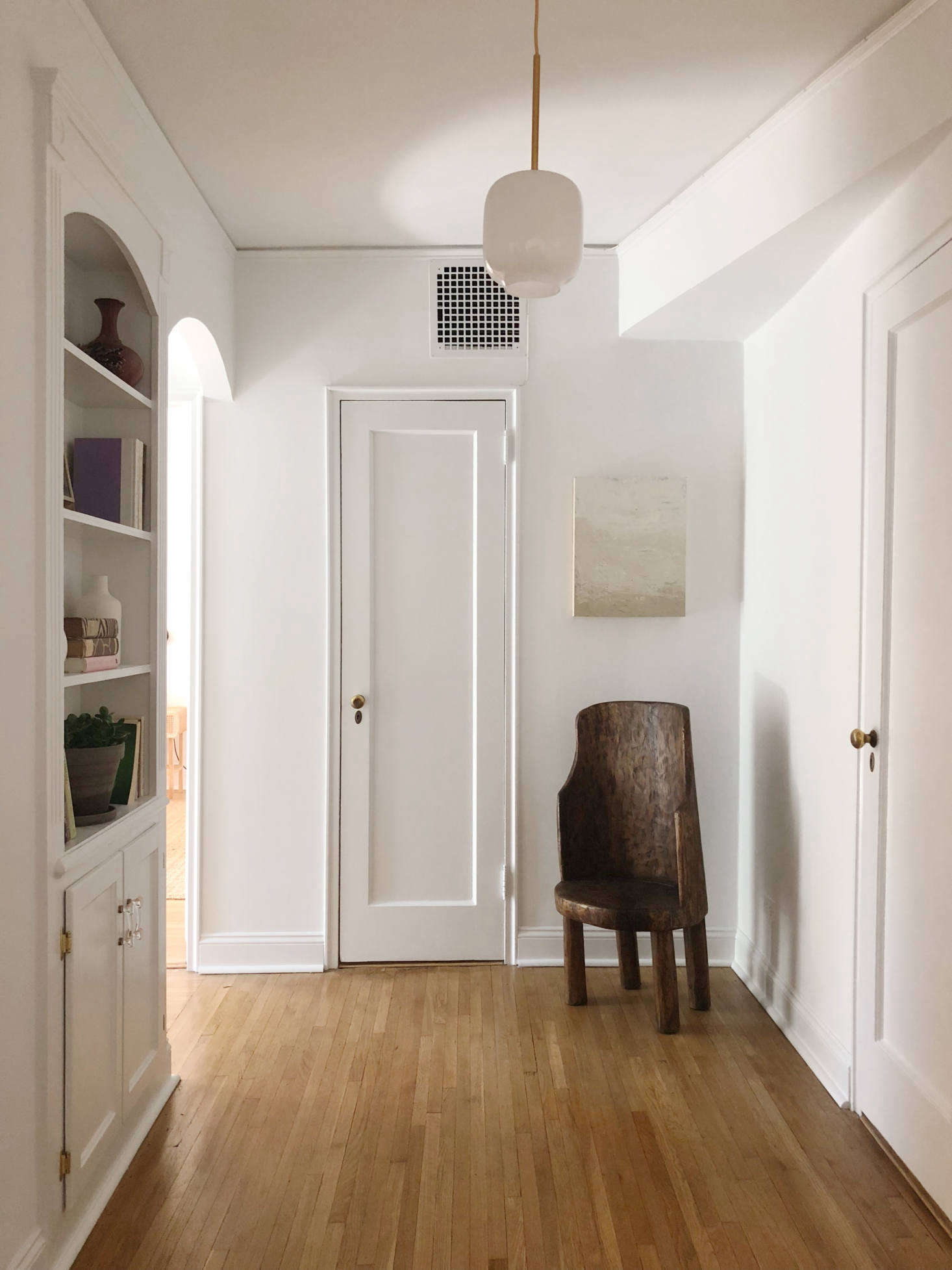 Flattering light is a staging essential. In a hall at 40 Prospect Park West, the Hoveys hung a current favorite of theirs, West Elm's Sculptural Milk Glass Pebble Pendant, $79.