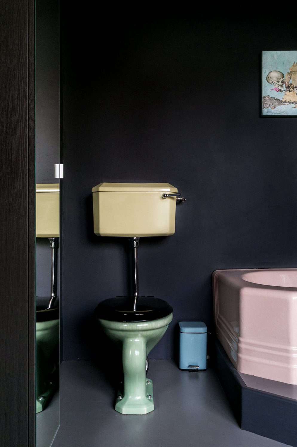 In his Yard House project, Jonathan Tuckey used pastel fixtures against a dark, moody