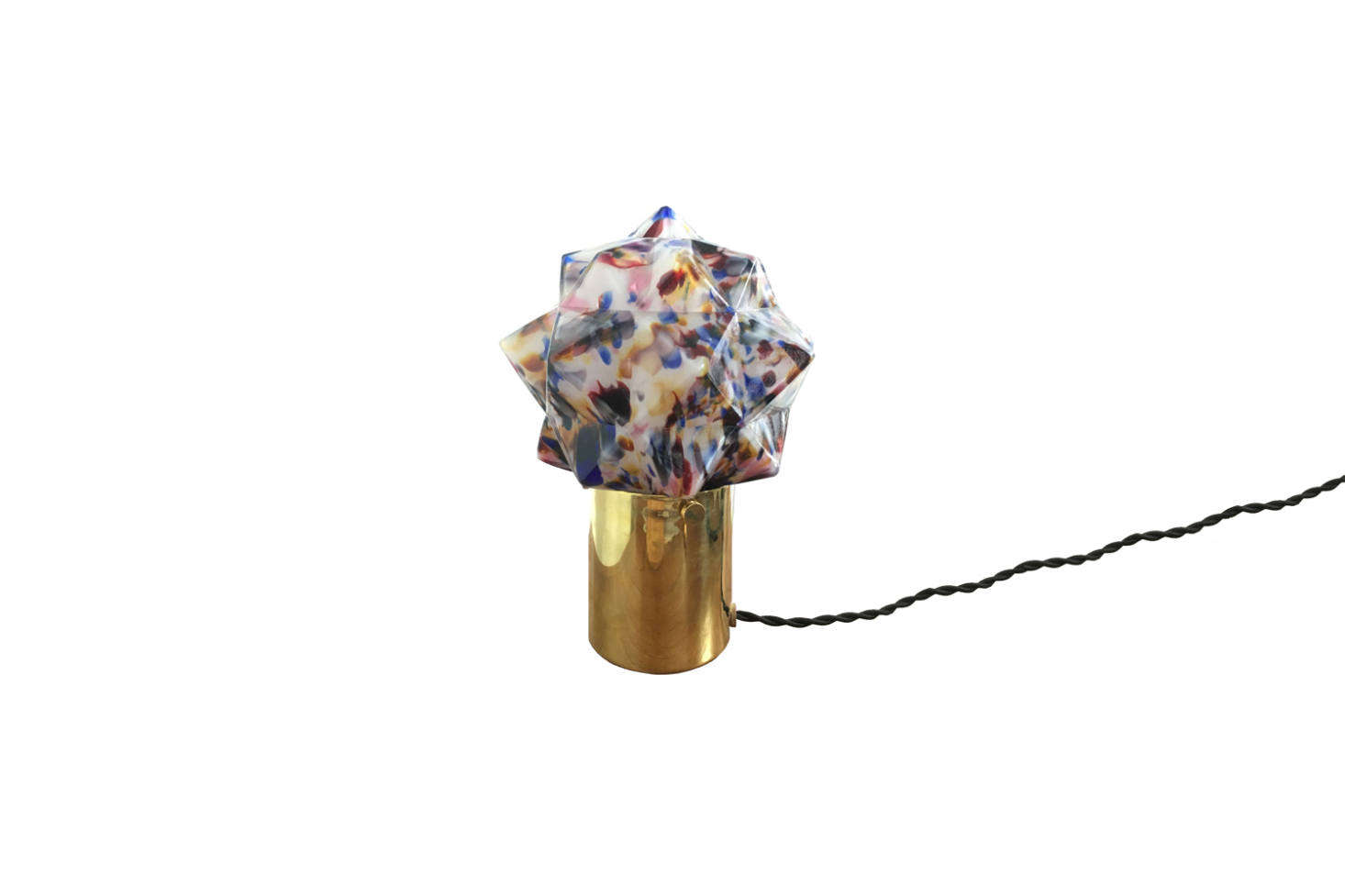The Penelope August Star Table Lamp is the designer's own design and is made with vintage Czech glass and an unlacquered brass base for $975 direct from Penelope August.