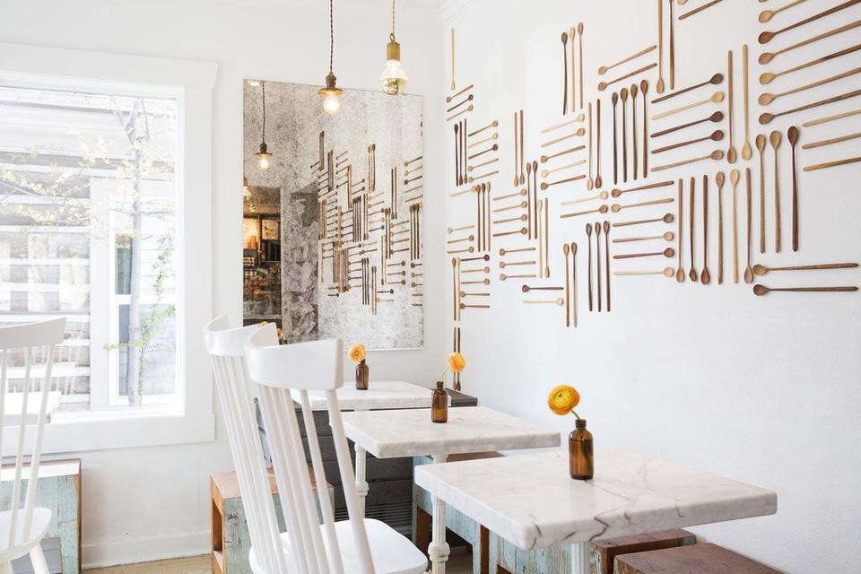Slim wooden spoons displayed in an abstract grid look sleek and elegant at Persephone Bakery in Jackson Hole, Wyoming. Photograph courtesy of Persephone Bakery.