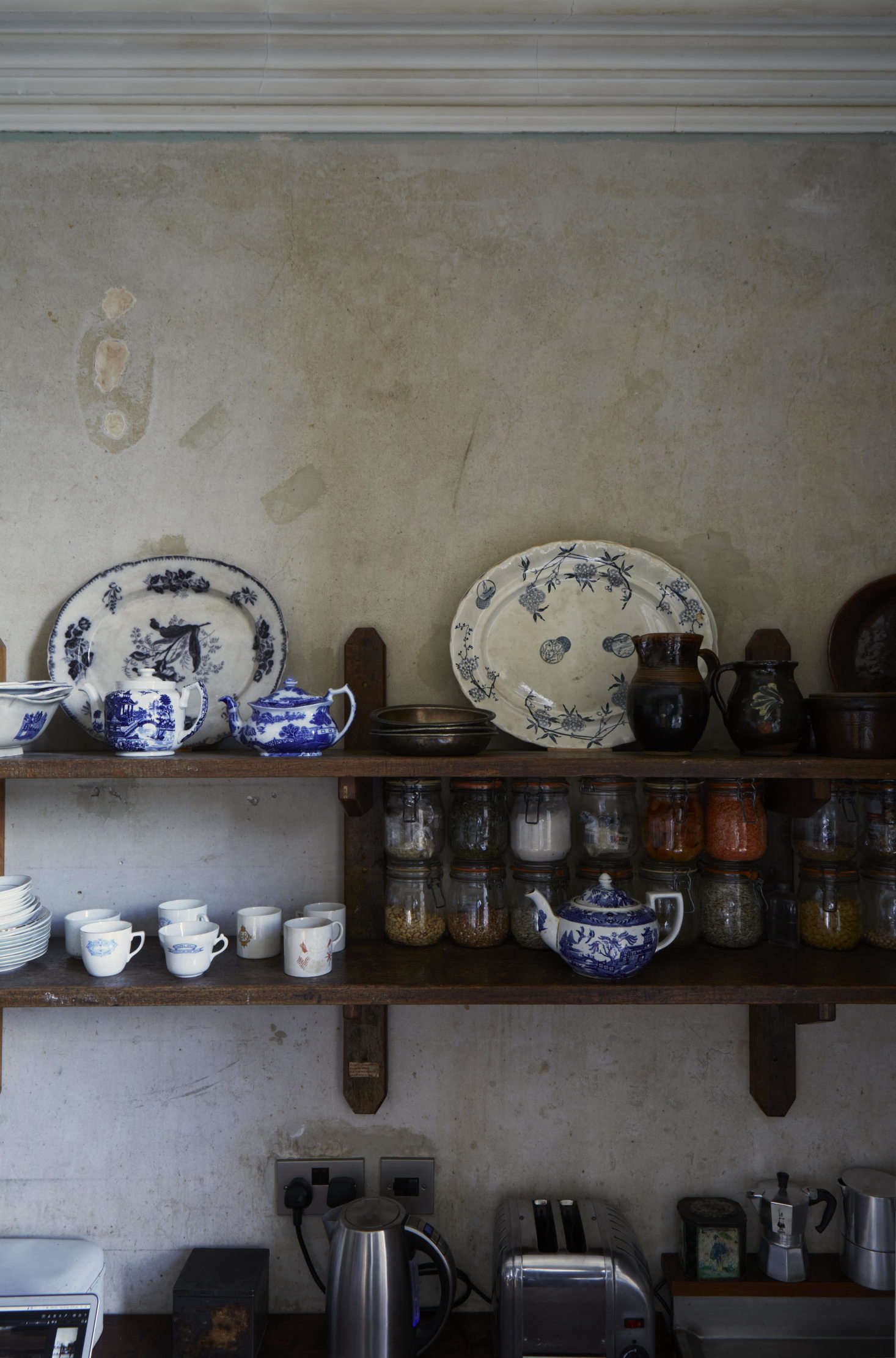 The couple's tableware of choice is antique blue-and-white china gathered over many years from car boot sales and charity shops.