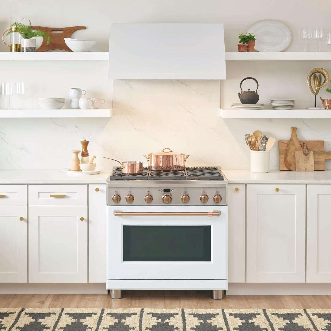 The Café 36-Inch Dual FuelProfessional Range with 6 Burners is available with either a white or black matte finish and a choice of hardware; $7,199 (the same range is available at AJ Madison for $6,473). The Café 36-Inch Commercial Hood is $1,499.