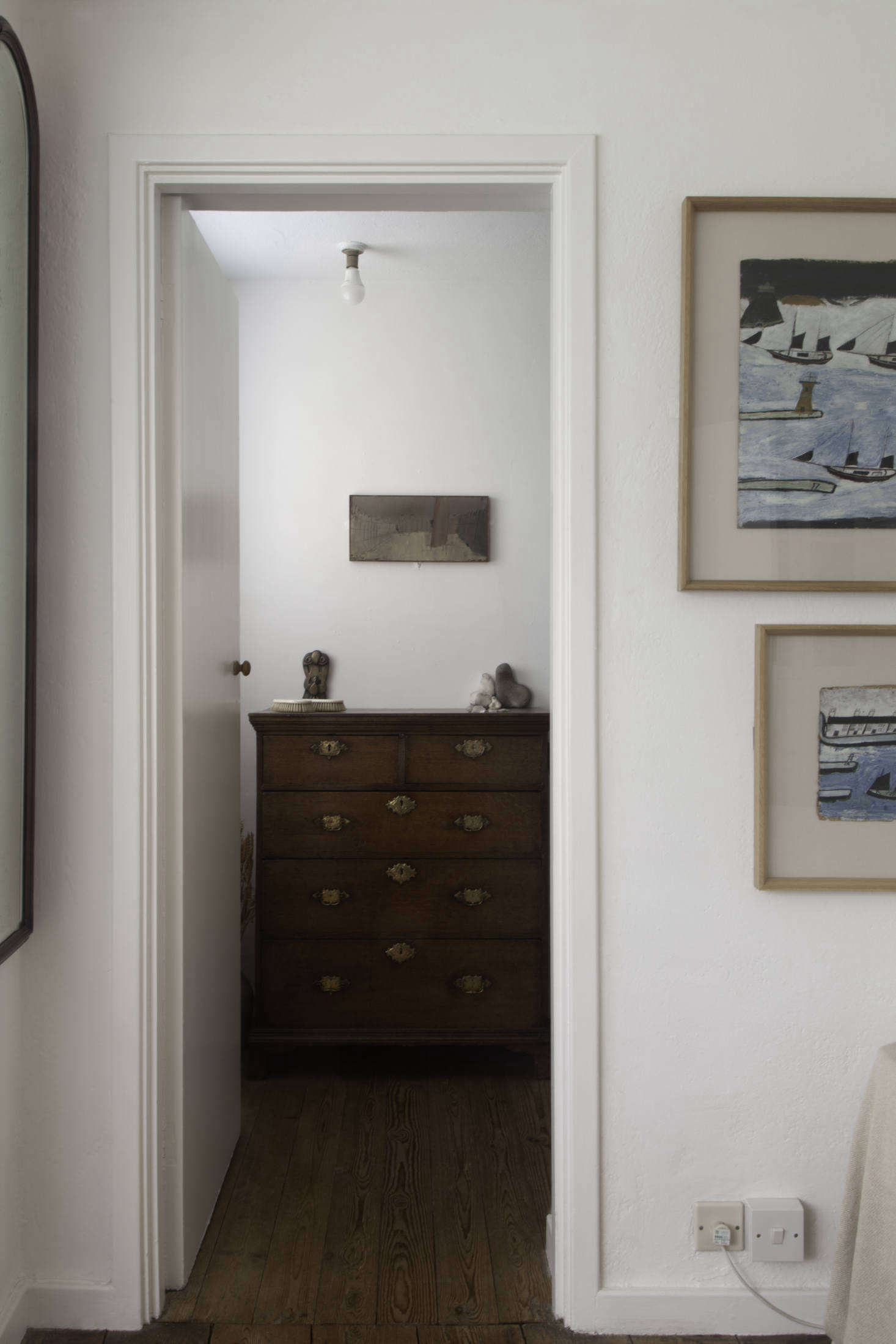 The Henri Gaudier-Brzeska brass Door-Knockersits on the dresser. On the wall is Piazza San Marco no. 5 by William Congdon.