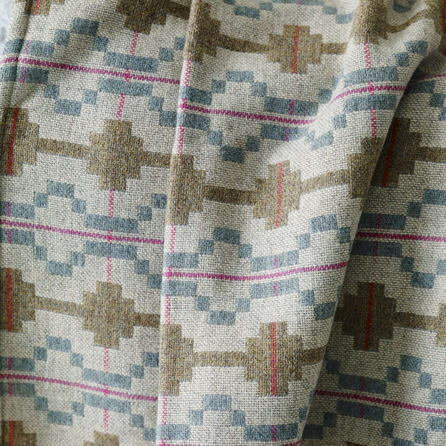 A detail of the blue and olive green wovenKinmel Blanketfrom Rowen & Wren. They also carry the Towyn Striped Blanket from Melin Tregwynt; £src=