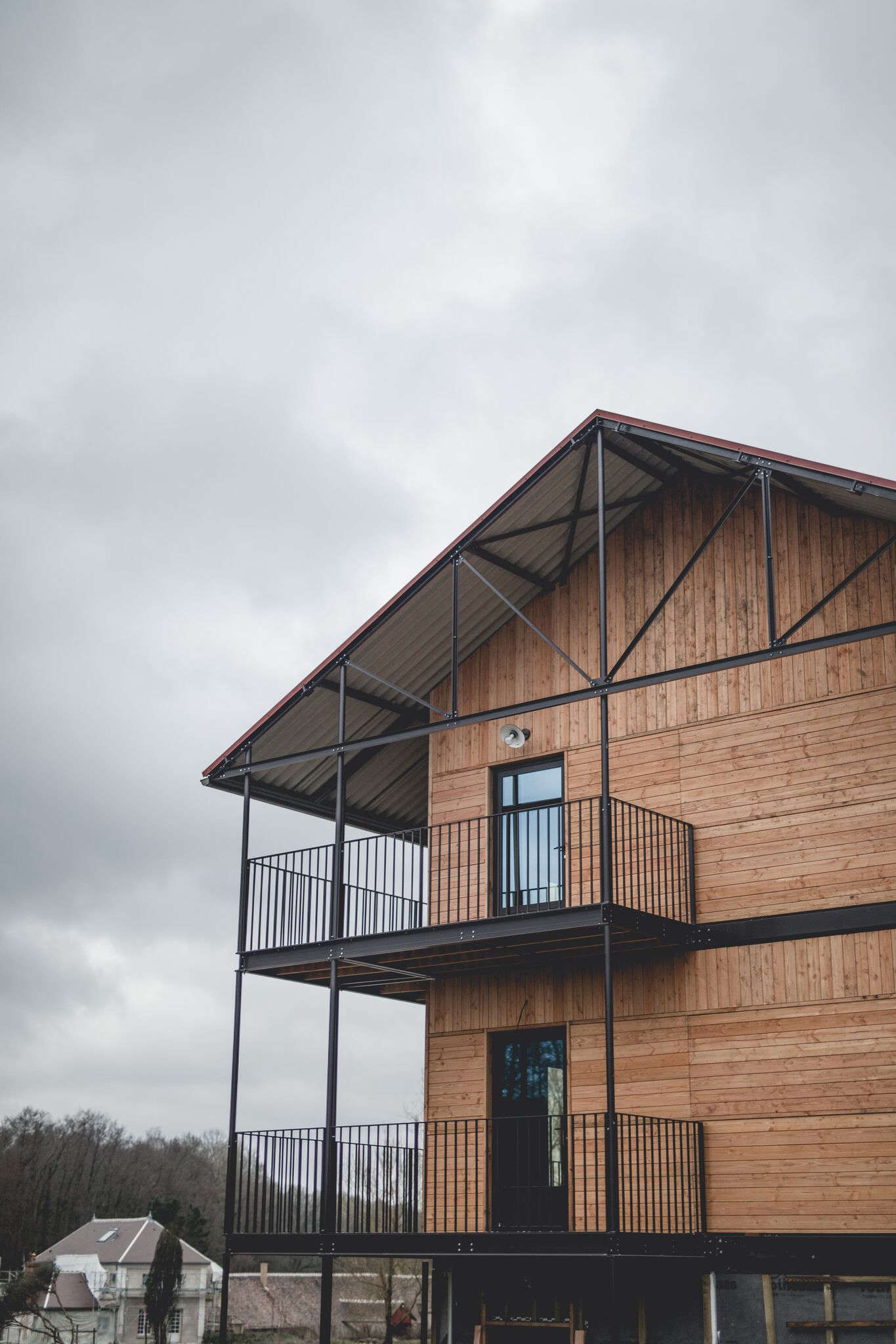 The Be-Poles team turned existing barns into hotel quarters that combine &#8