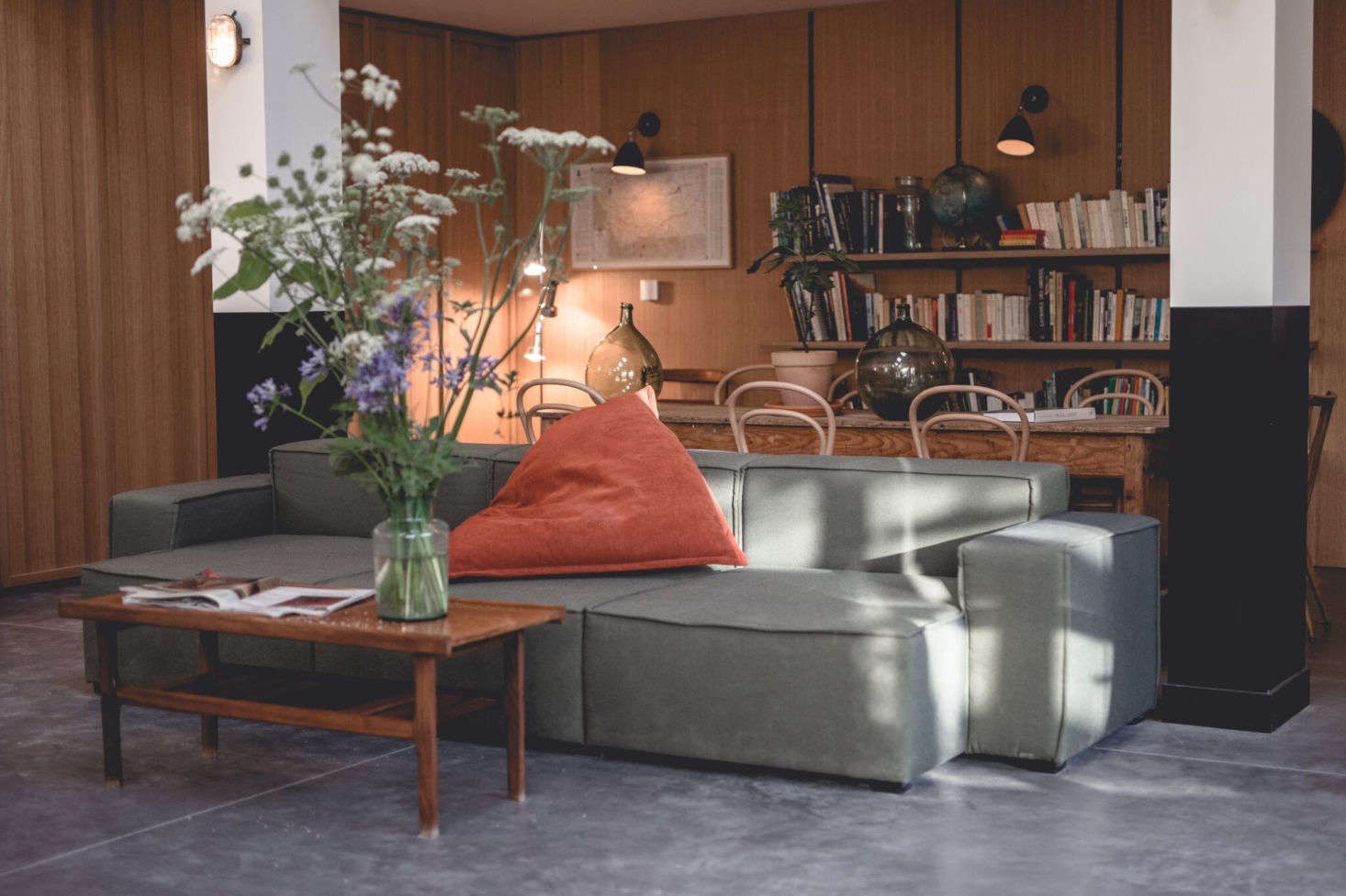 An extra-wide sofa for lounging in the library area.