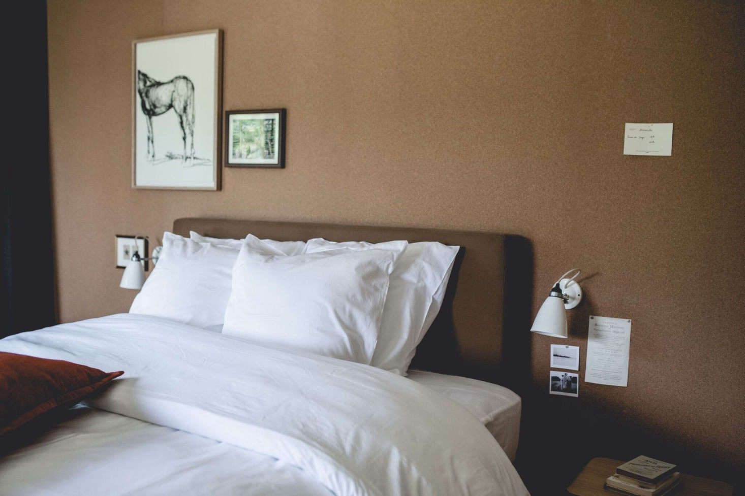 Beds are set against cork-lined walls ideal for displaying art.